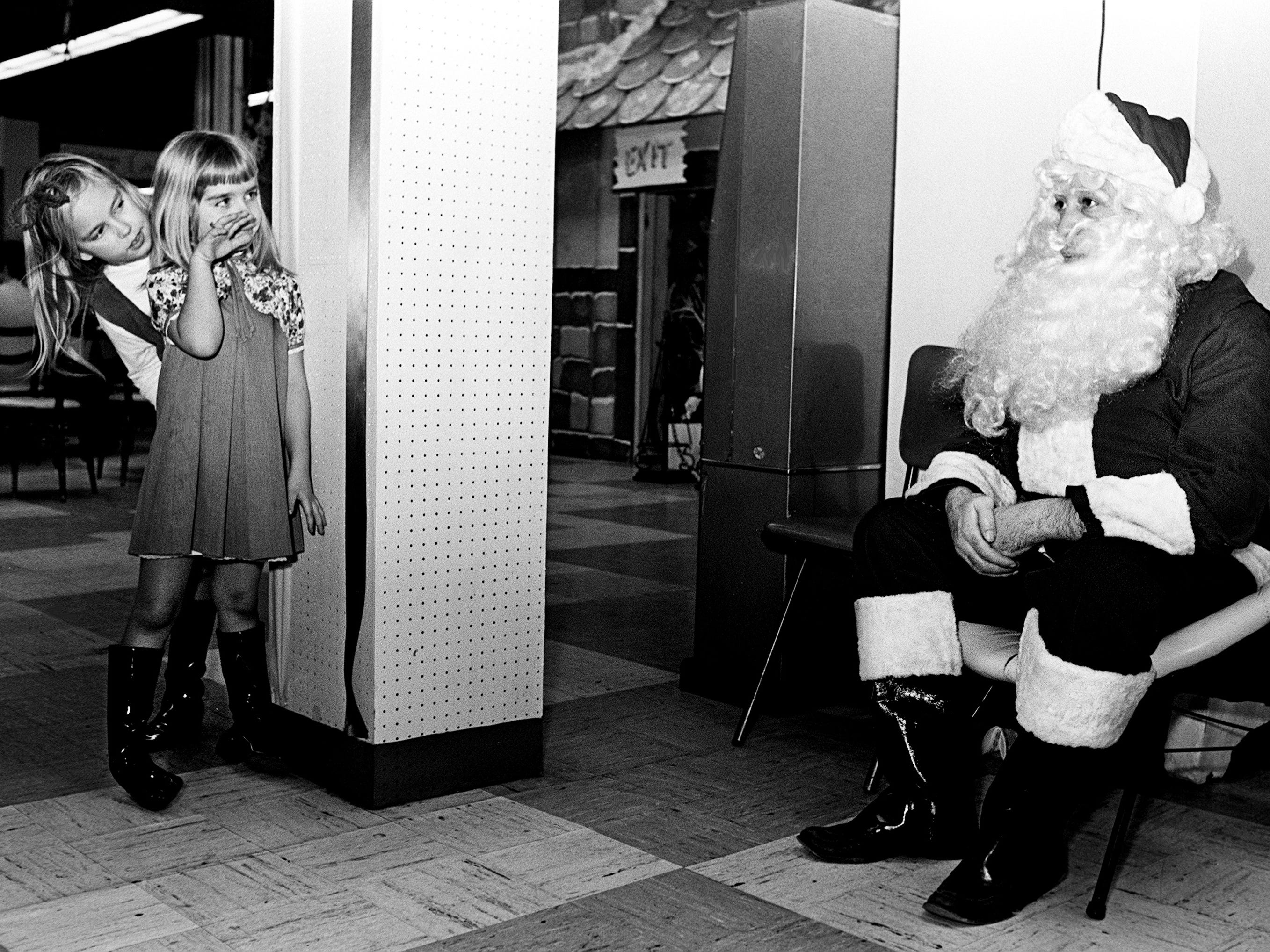 Marie Warren, 8, left, and sister Linda, 5, want to talk to Santa, but can't decide who should go first Dec. 13, 1968. The girls are the daughters of Mr. and Mrs. George Warren of Langford Cove, Old Hickory Lake.