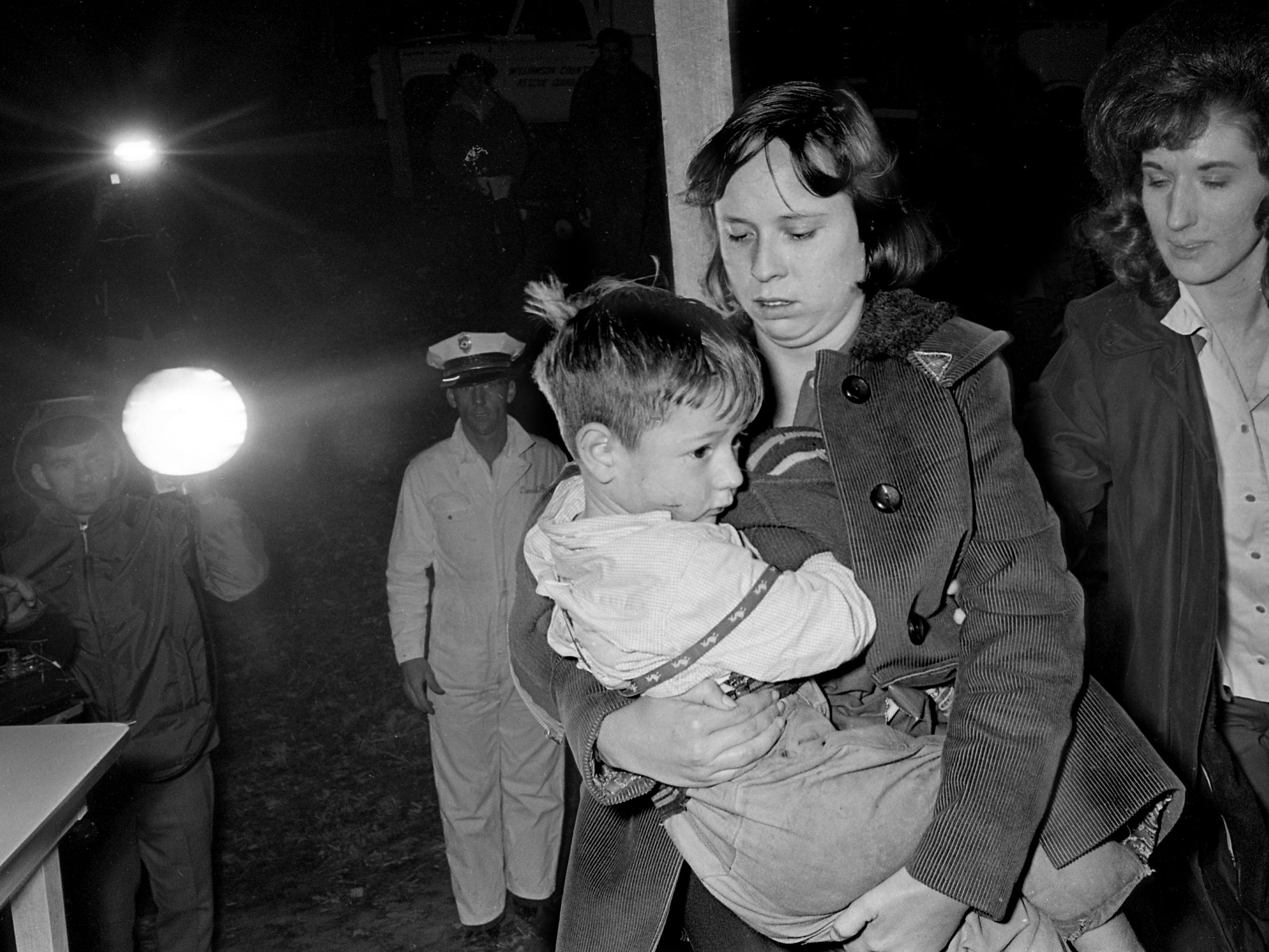 "Young Joseph ""Bubba"" Andrews is hugged by his tearful mother, Mrs. Joe Andrews, after the chilled 4-year-old was found lying beside a gravel road with his dog after the pair were lost in the woods of western Williamson County for nearly 12 hours Dec. 4, 1968."