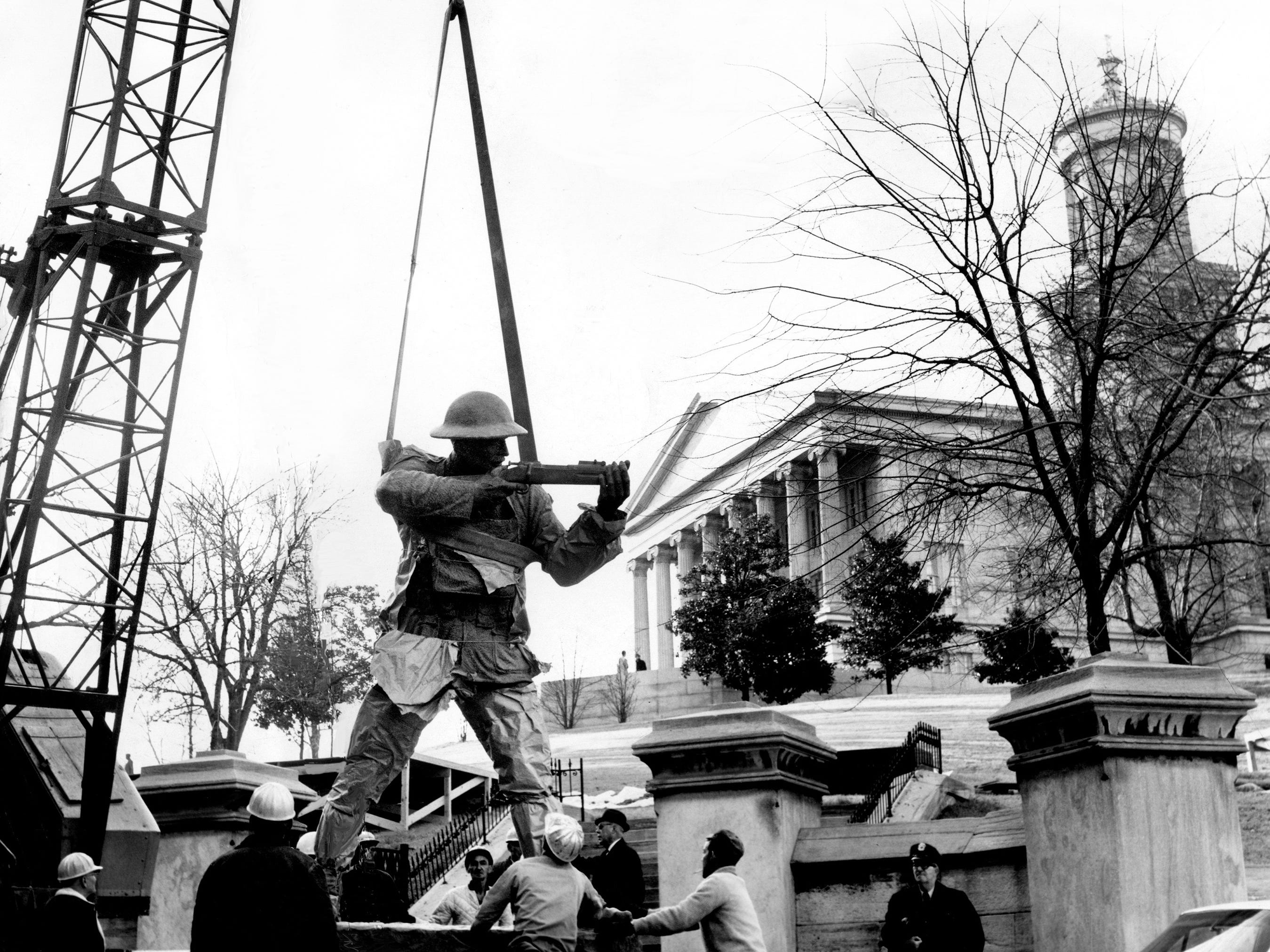 "A large crane lifts into place on the southeast corner of the Tennessee state Capitol grounds a 10-foot-high bronze statue of Sgt. Alvin C. York on Dec. 12, 1968. The statue will be unveiled by York's widow, ""Miss Gracie,"" in ceremonies the next day."