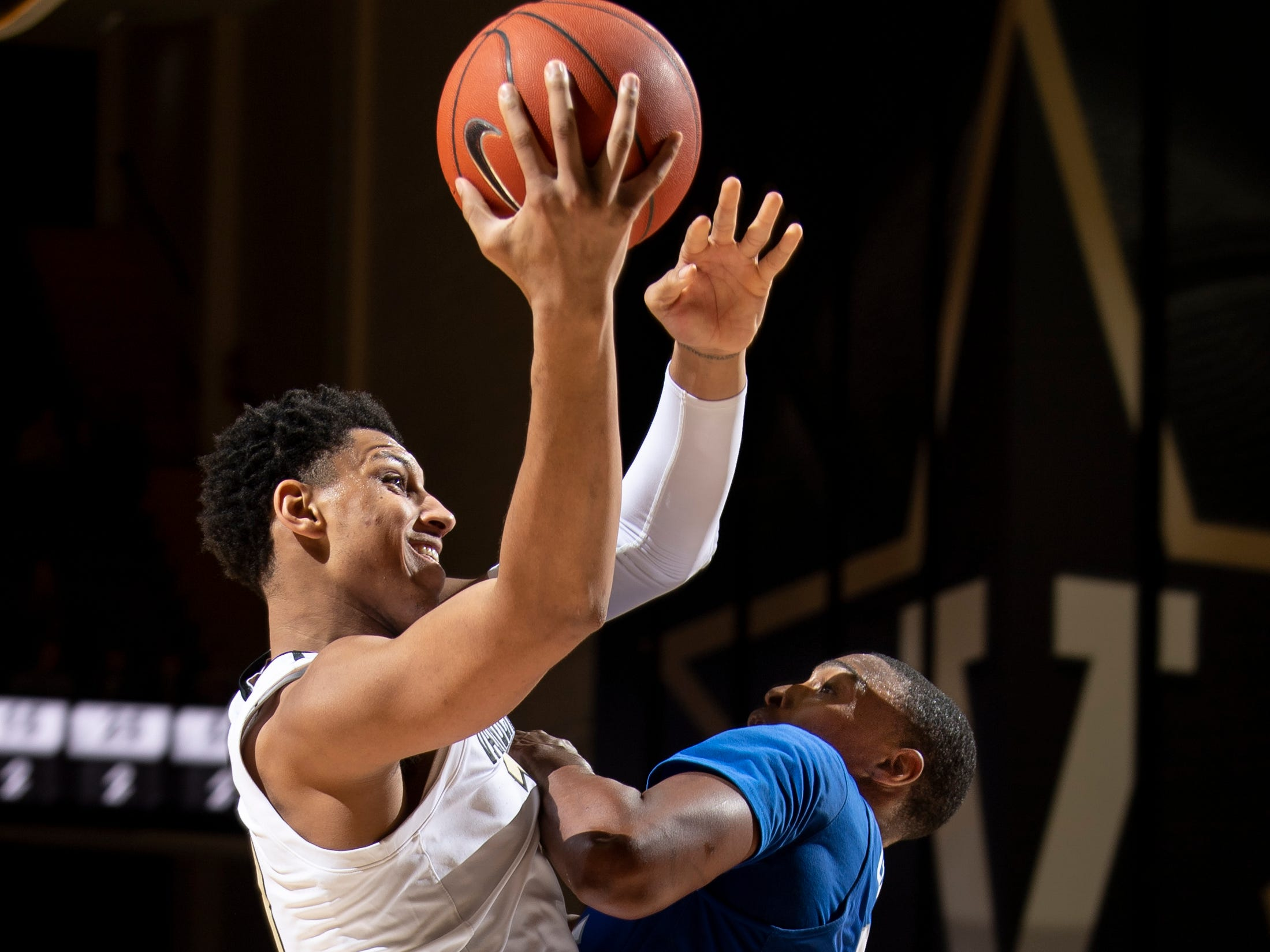 Vanderbilt forward Matthew Moyer (13) is fouled by MTSU forward Karl Gamble (25) during the first half at Memorial Gym in Nashville, Tenn., Wednesday, Dec. 5, 2018.
