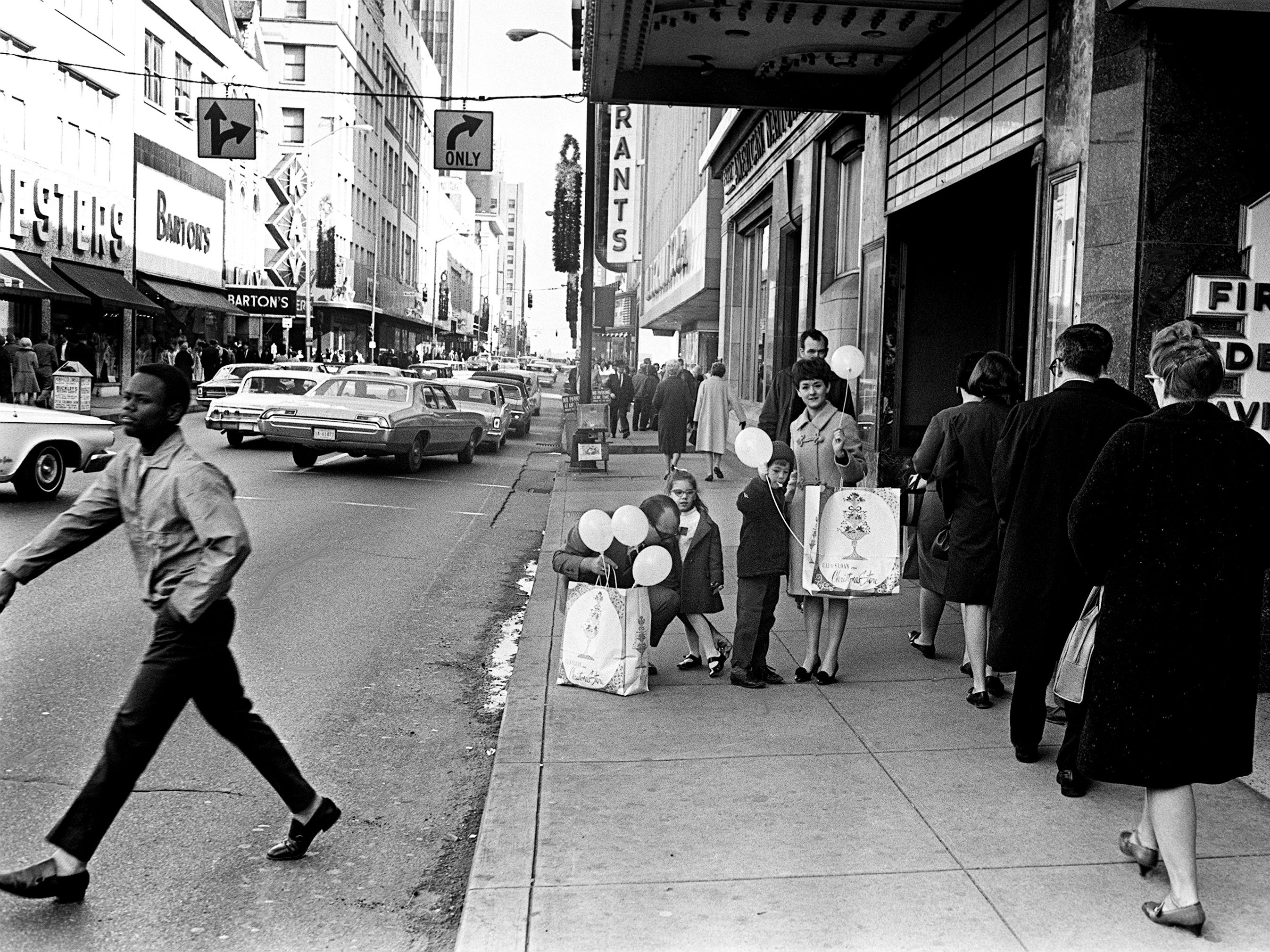 Getting an early start on Christmas shopping, shoppers and cars are packing Church Street in downtown Nashville Nov. 30, 1968.