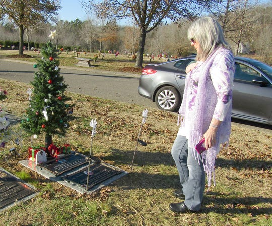 Rebecca Winner gets her first look at her nephew Chase Sullivan's grave marker. Sullivan was shot and killed by Fairview police officers responding to a welfare check in August 2018.
