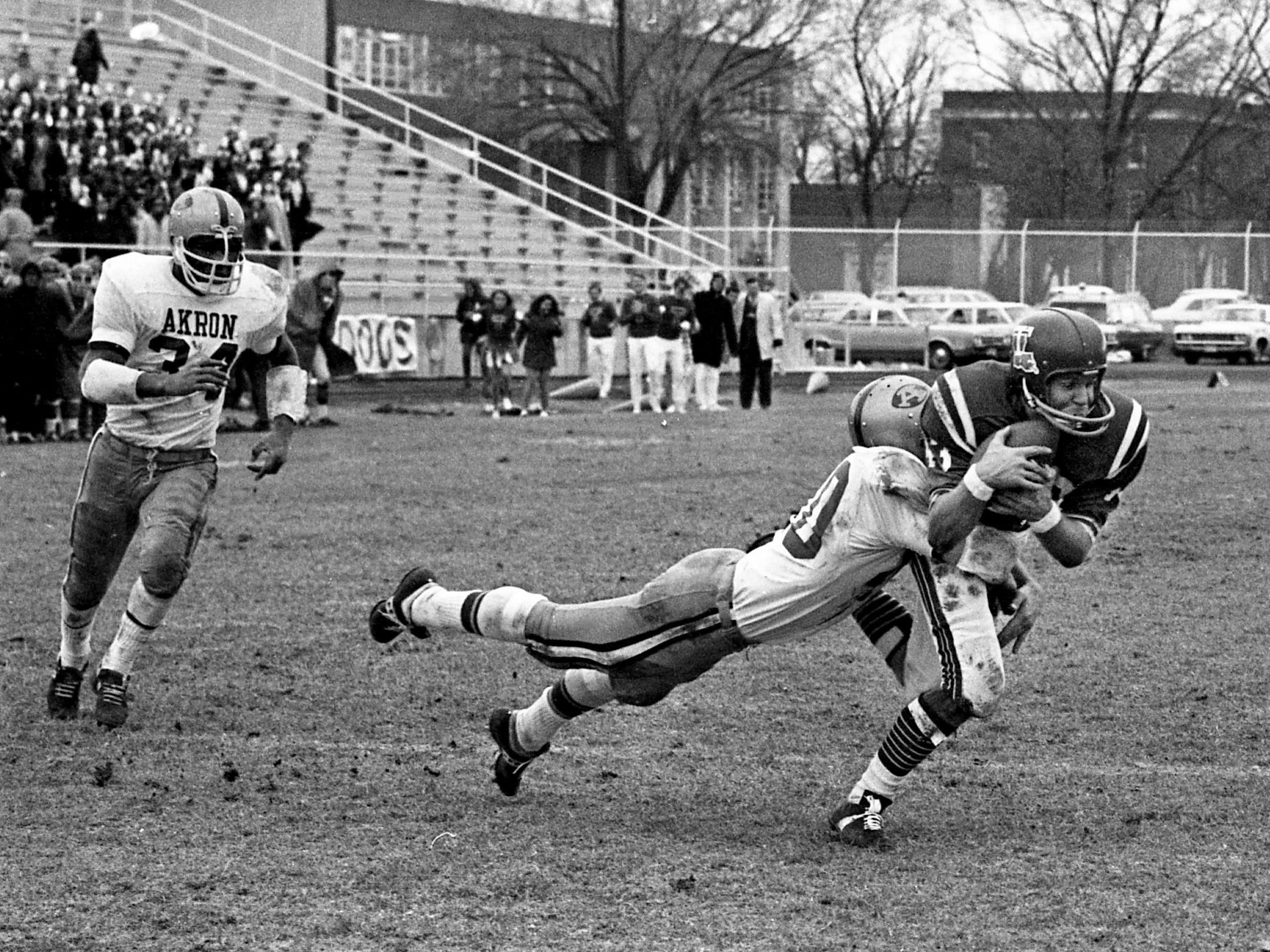 Louisiana Tech receiver Tommy Spinks, right, is tackled by Akron defender Tony Pallija after catching one of his 12 receptions in their 33-13 victory in the fifth annual Grantland Rice Bowl at Middle Tennessee State University on Dec. 14, 1968.