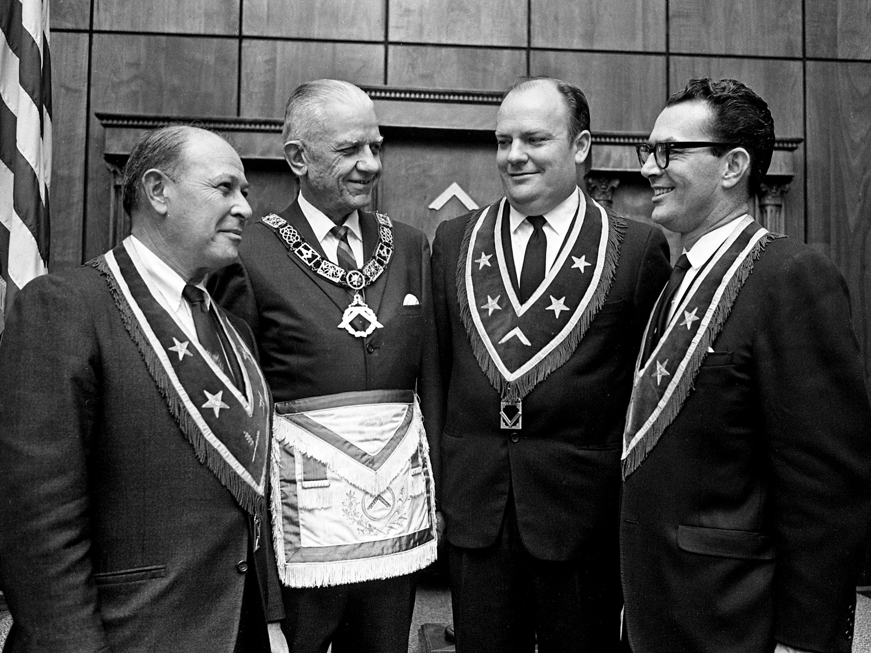 Members of Cumberland Lodge No. 8 F & A.M. discuss plans during dedication ceremonies of the lodge's new temple on Sloan Road on Dec. 7, 1968. They are Louis Steinberg, left, secretary; John Riley, deputy grand master; J.E. Bennett, worshipful master; and Metro Sheriff John Frazier, past master.