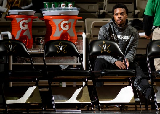 Vanderbilt guard Darius Garland sits behind the bench during the first half against MTSU at Memorial Gym in Nashville, Tenn., Wednesday, Dec. 5, 2018. Garland is currently out with an injury.