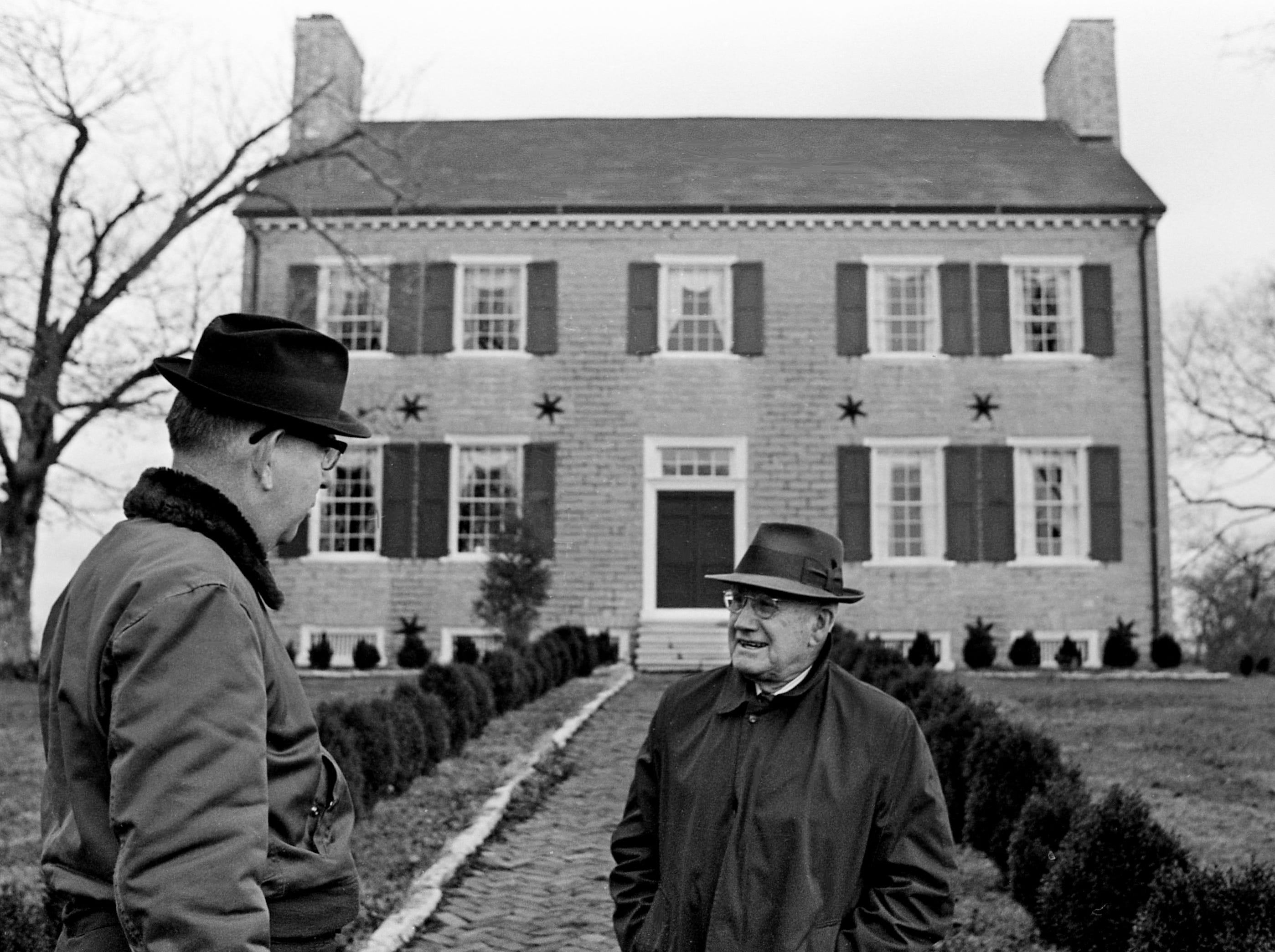 George Wynne, right, great-grandson of Gen. James Winchester, wishes bon voyage to Tennessean feature editor Hugh Walker at the gate of Cragfont on Dec. 2, 1968, as Walker prepares to follow the route of Winchester and his Kentucky troops to the River Raisin in southeastern Michigan during the War of 1812.