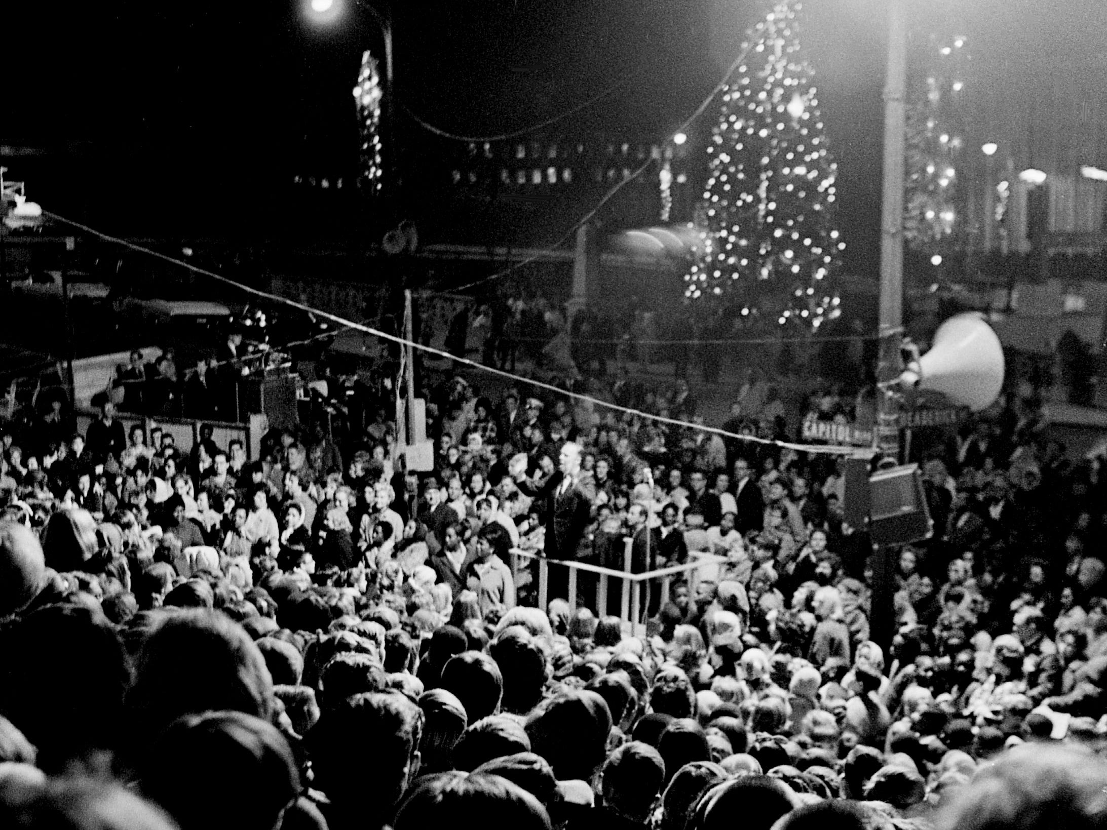 Metro schools system's sixth grade choir are performing during the annual Christmas tree lighting ceremony by Metro Mayor Beverly Briley at Memorial Square Nov. 26, 1968.