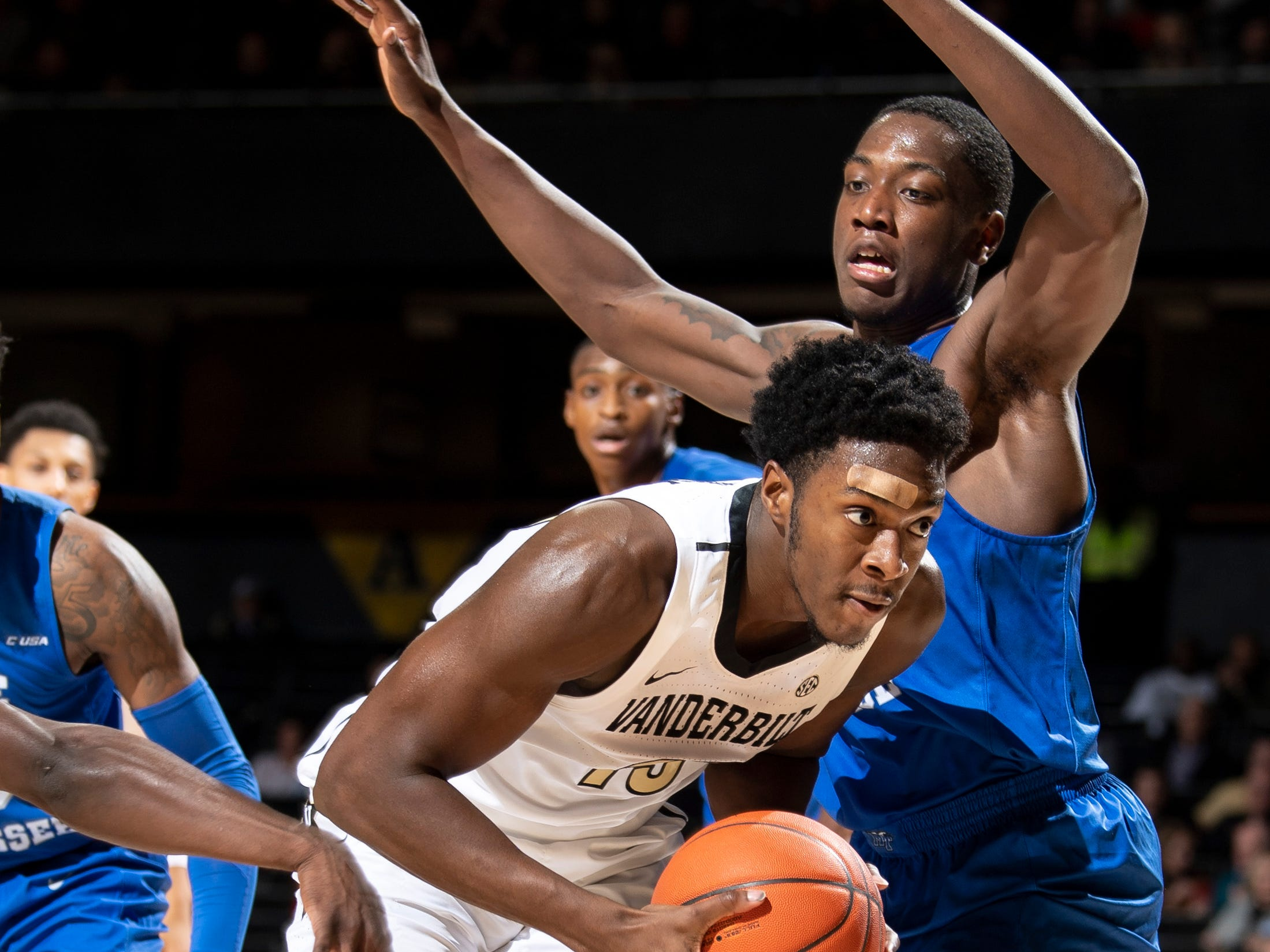 Vanderbilt forward Clevon Brown (15) advances past MTSU forward Reggie Scurry (22) during the first half at Memorial Gym in Nashville, Tenn., Wednesday, Dec. 5, 2018.