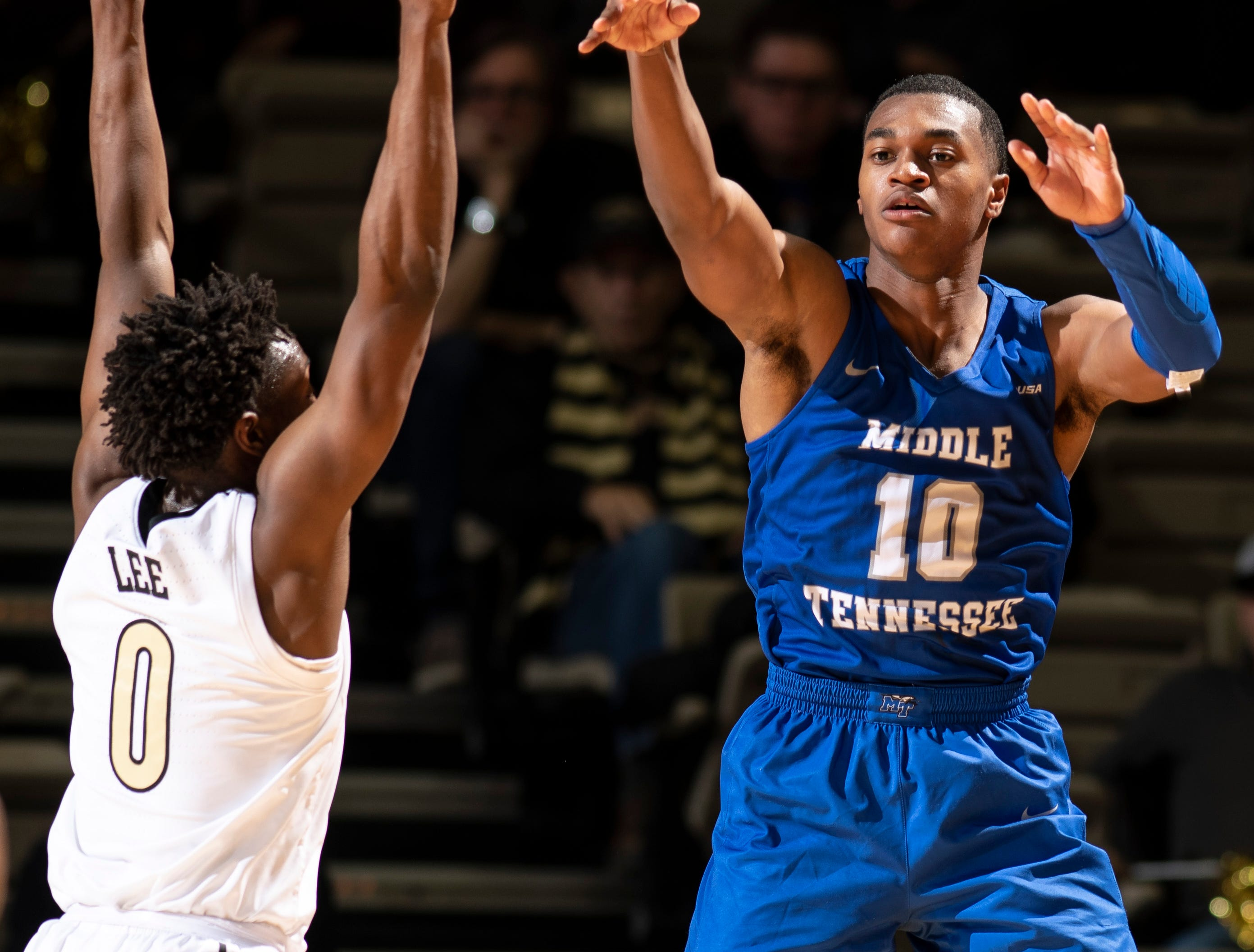 MTSU guard Jayce Johnson (10) passes over Vanderbilt guard Saben Lee (0) during the first half at Memorial Gym in Nashville, Tenn., Wednesday, Dec. 5, 2018.