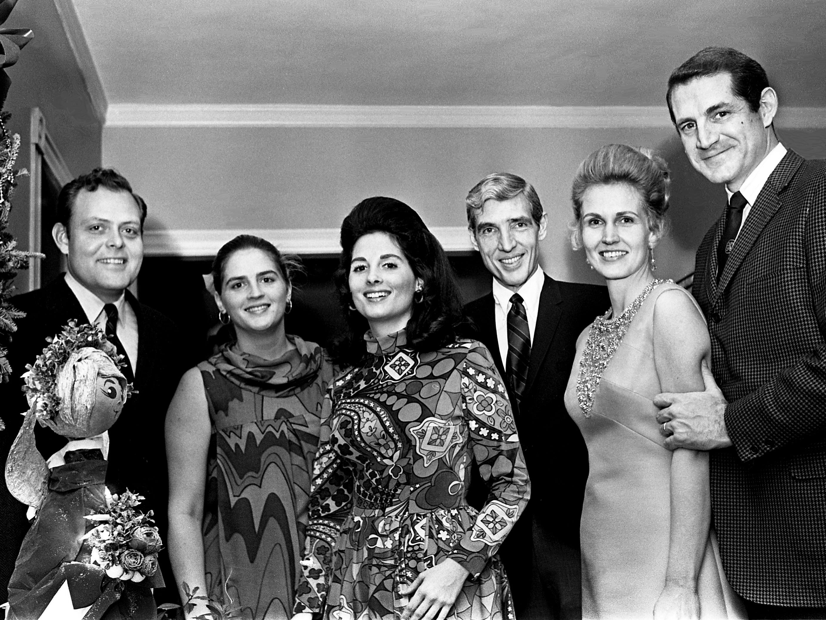 Host Tish Hooker, third from left, shares a moment with guests Mr. and Mrs. Gil Merritt, left, Thomas W. Steele, and Mrs. and Mr. Stirton Oman as she and her husband, John Jay Hooker Jr., have a holiday party in the Belle Meade apartment of his mother, Mrs. Darthula Hooker, on Dec. 22, 1968. The Hookers are staying with his mother while their home on Chickering Lane is under construction.