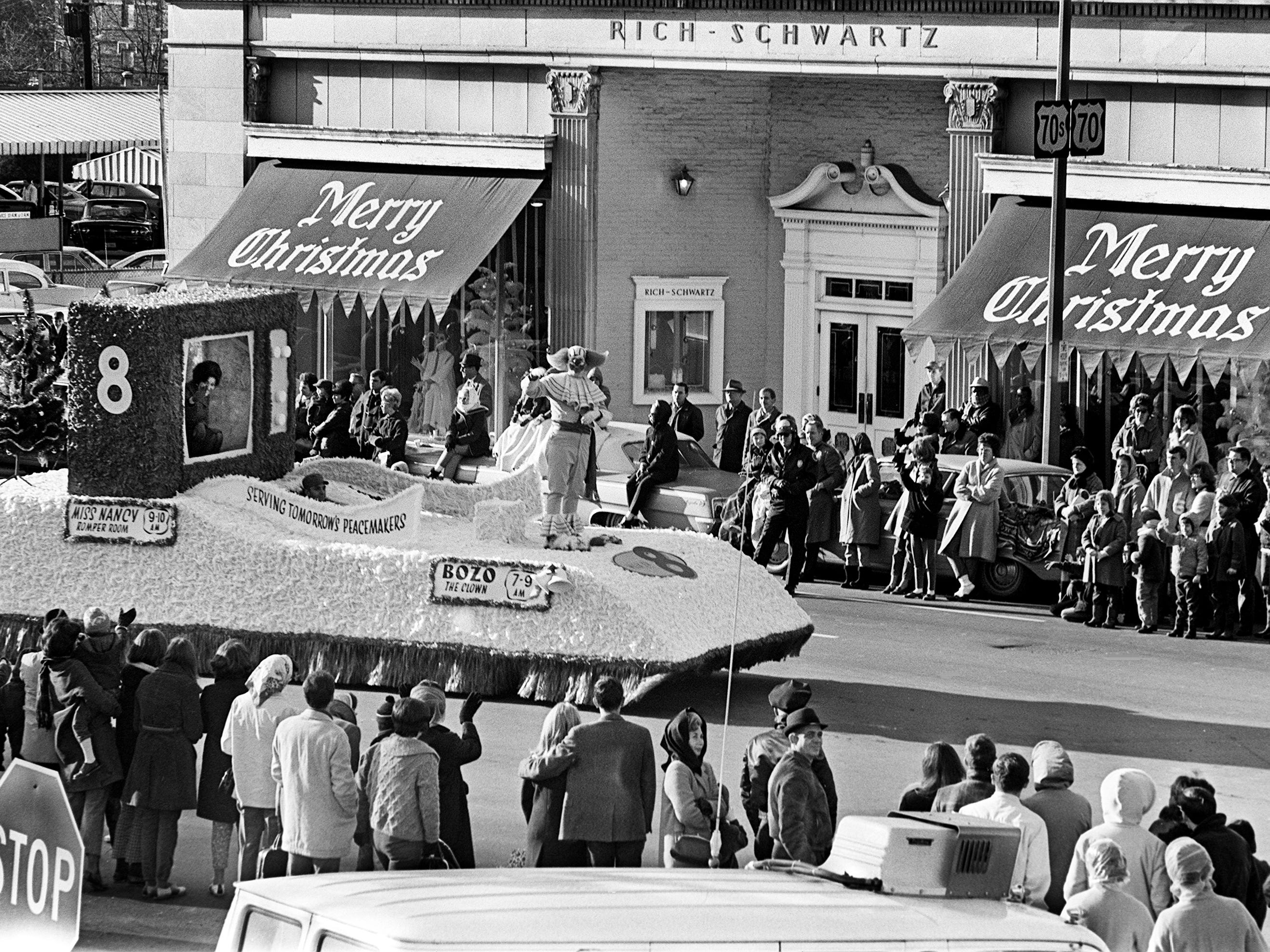 Bozo the Clown, center, and Miss Nancy, left, on the Channel 8 float, waves to the kids lining the street in front of the Rich-Schwartz store during the 16th annual Nashville Christmas parade Dec. 8, 1968.