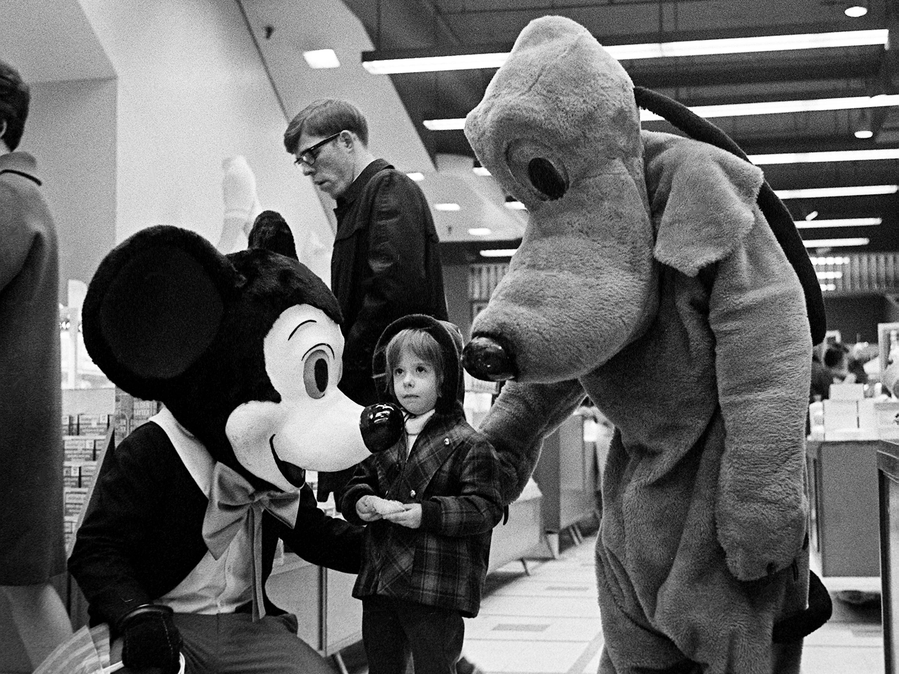 Tiny Nicole Jelesoff, 4, stares in amazement as she is confronted by Mickey Mouse and Pluto at Harveys in downtown Nashville Dec. 16, 1968. The popular Disney cartoon characters, brought to life by Glenn Gailbreath, 18, and Junior Warren, 17, greet young and old shoppers each day in the store. Nicole is the daughter of Mrs. A.D. Jelesoff of Capitol Towers Apartments.