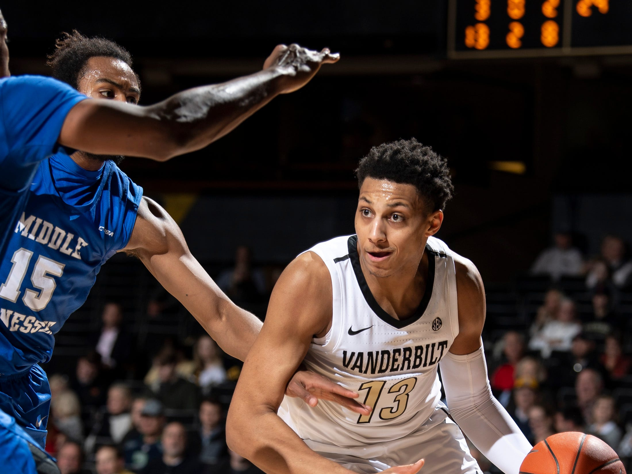 Vanderbilt forward Matthew Moyer (13) advances into MTSU forward TJ Massenburg (15) during the first half at Memorial Gym in Nashville, Tenn., Wednesday, Dec. 5, 2018.