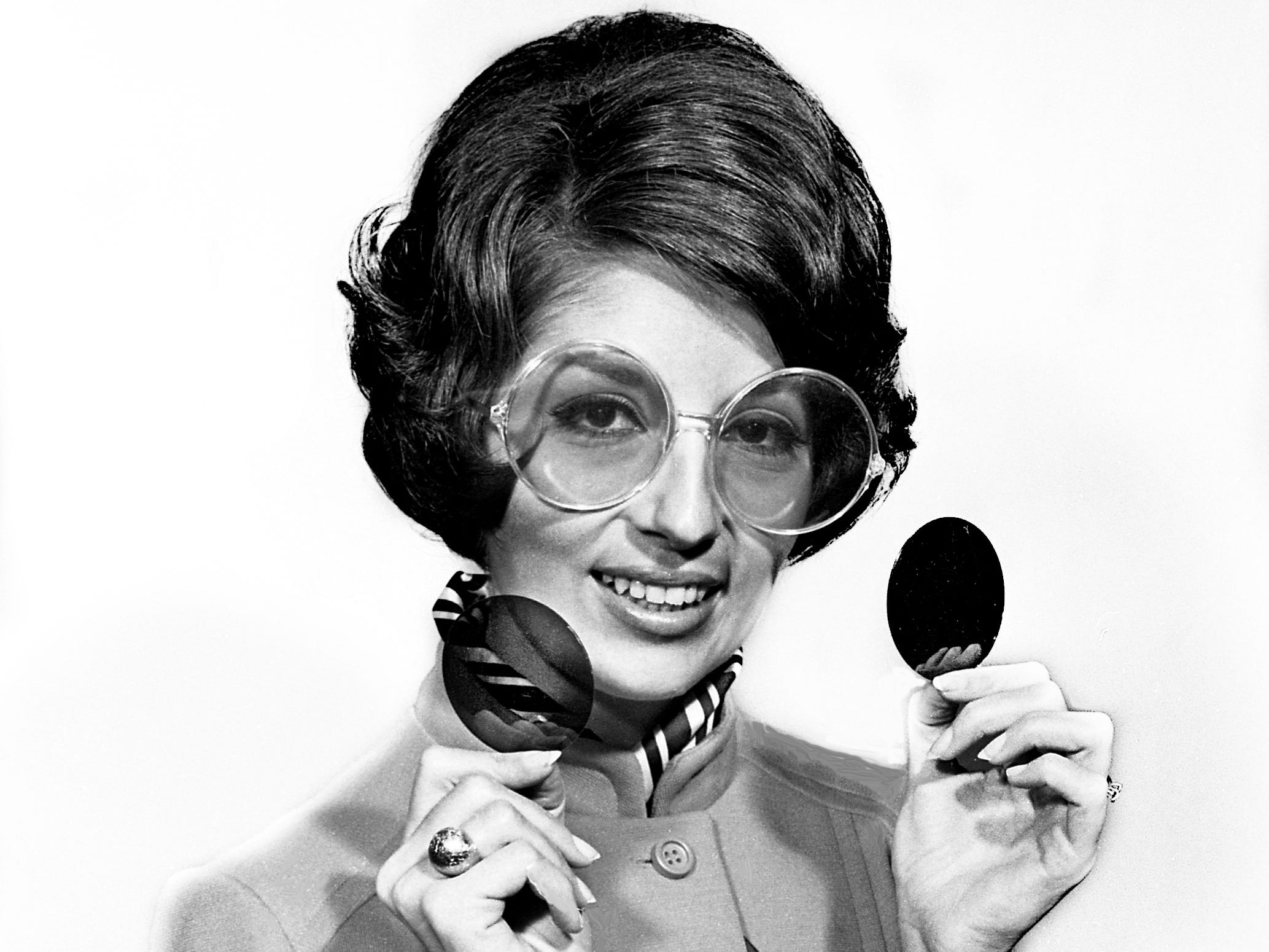 Looking for that Christmas gift for someone special, model Mary Helen Cope is wearing giant-sized round shades that come with seven interchangeable lenses Dec. 5, 1968 and the set is $5.95 at Sears.