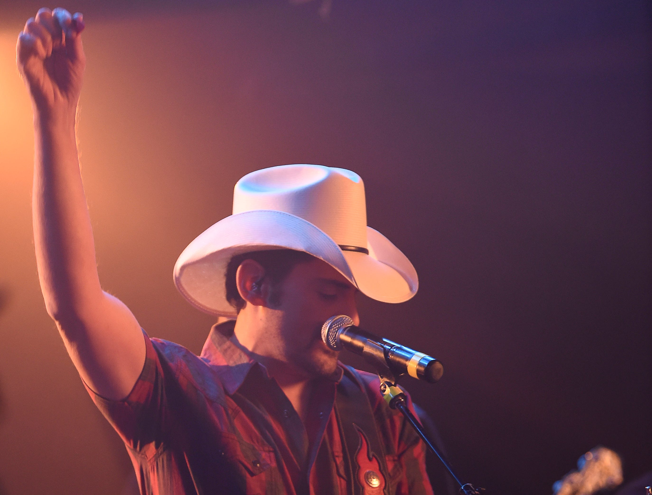 "Brad Paisley performs as he shoots a video for his new song ""Bucked Off"" at Tootsie's Orchid Lounge Wednesday, Dec. 5, 2018, in Nashville, Tenn."