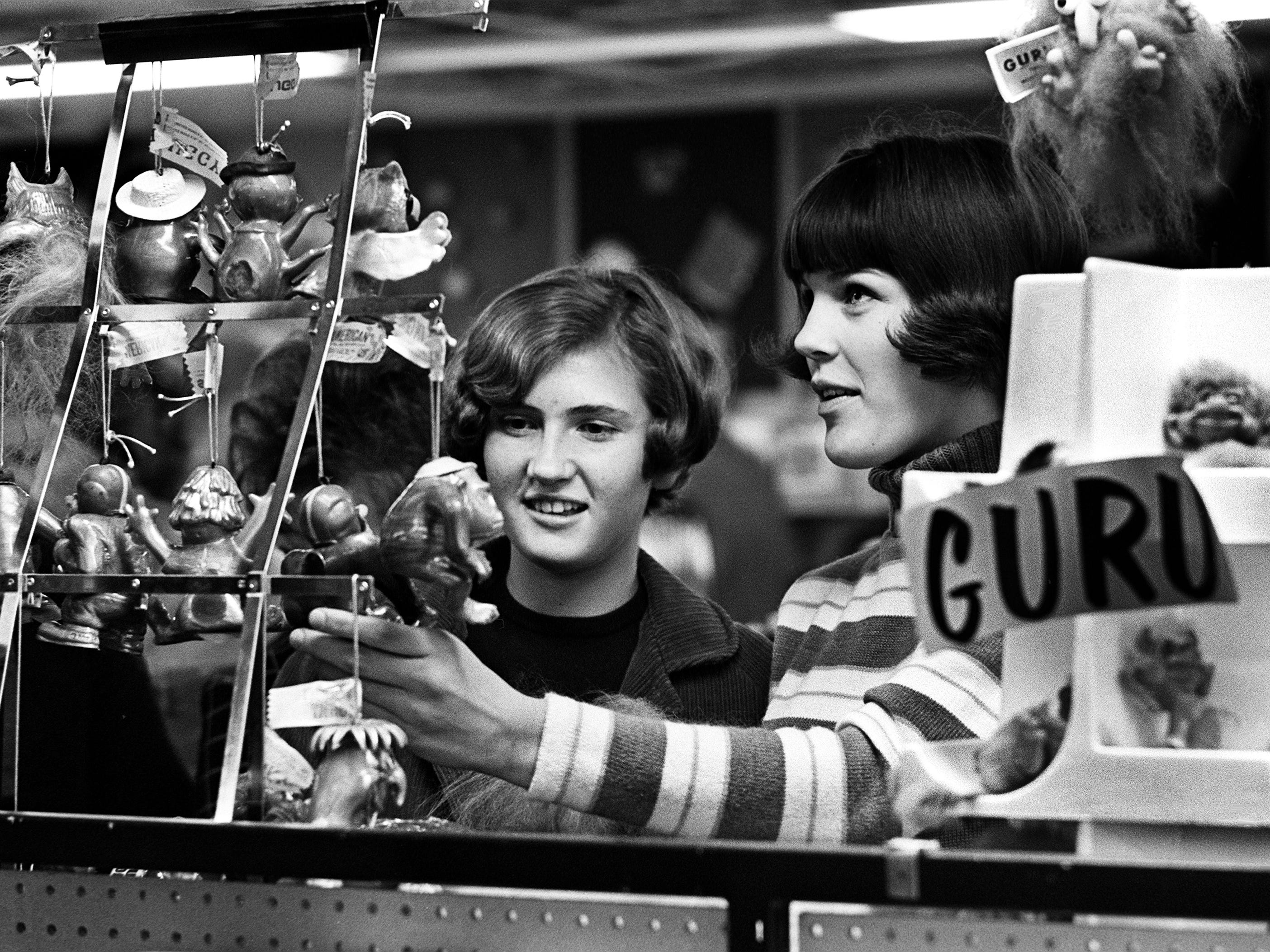 Julie Creek, left, and Sandra Smith look for an unusual Christmas gift for someone on their shopping list Dec. 7, 1968.