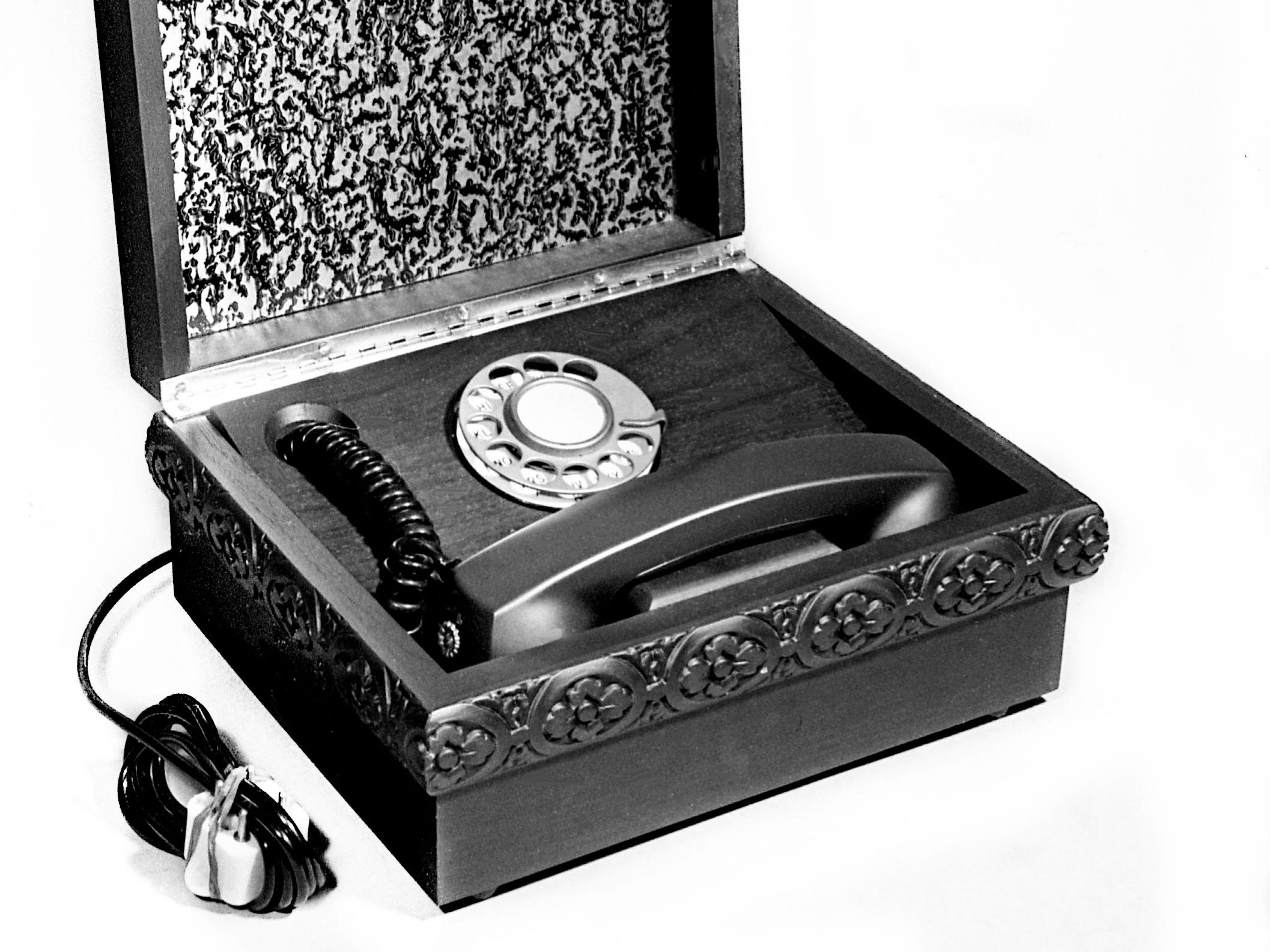 Looking for that Christmas gift for the already well-gifted man, here Dec. 5, 1968 is a telephone box that cost $90 at the Village Store.