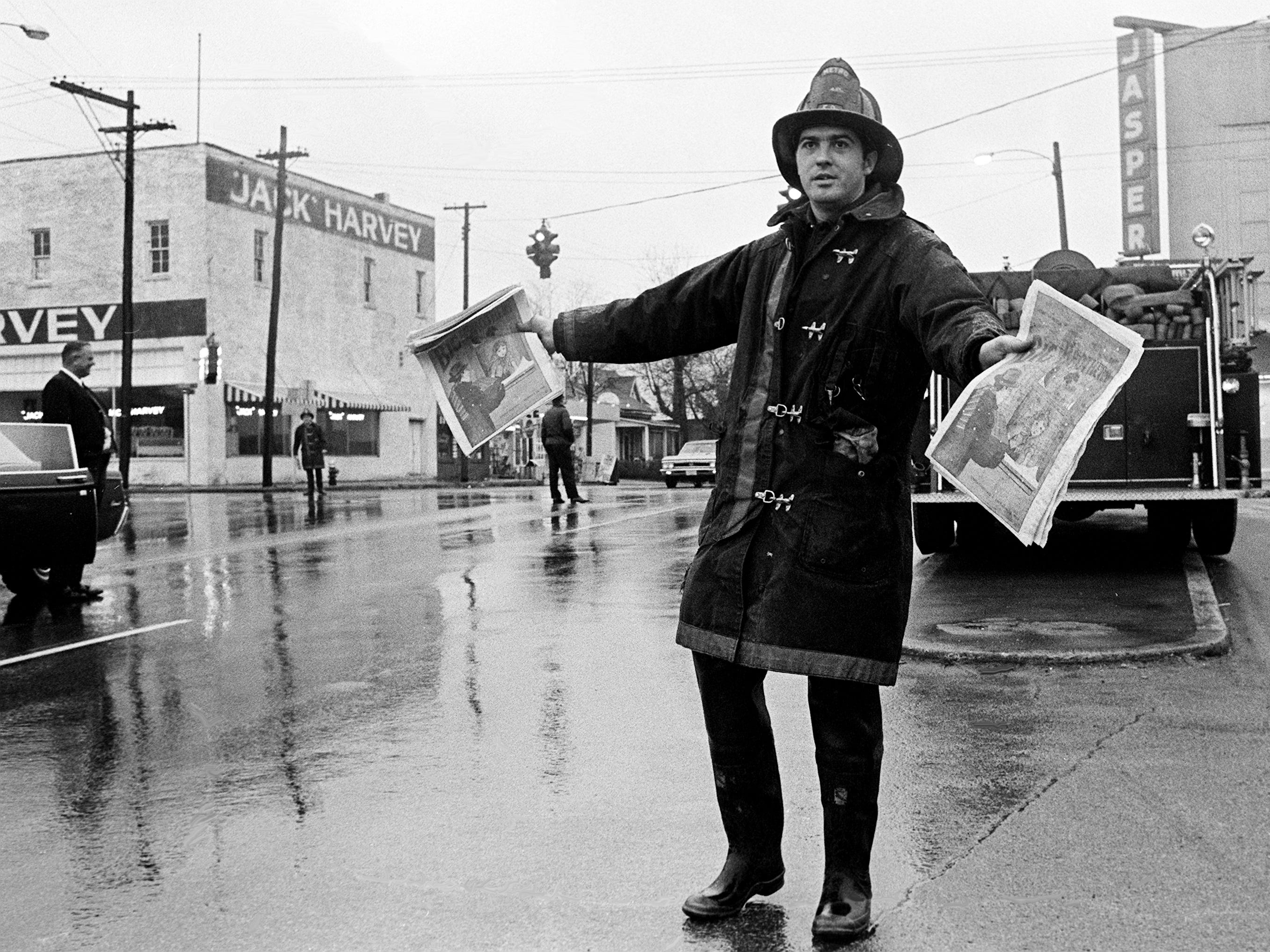 Metro firefighter Billy R. Carrigan of Ridgewood Road displays the smartest attire for workers in the rain-soaked Big Brothers annual Christmas tabloid sale Dec. 22, 1968.