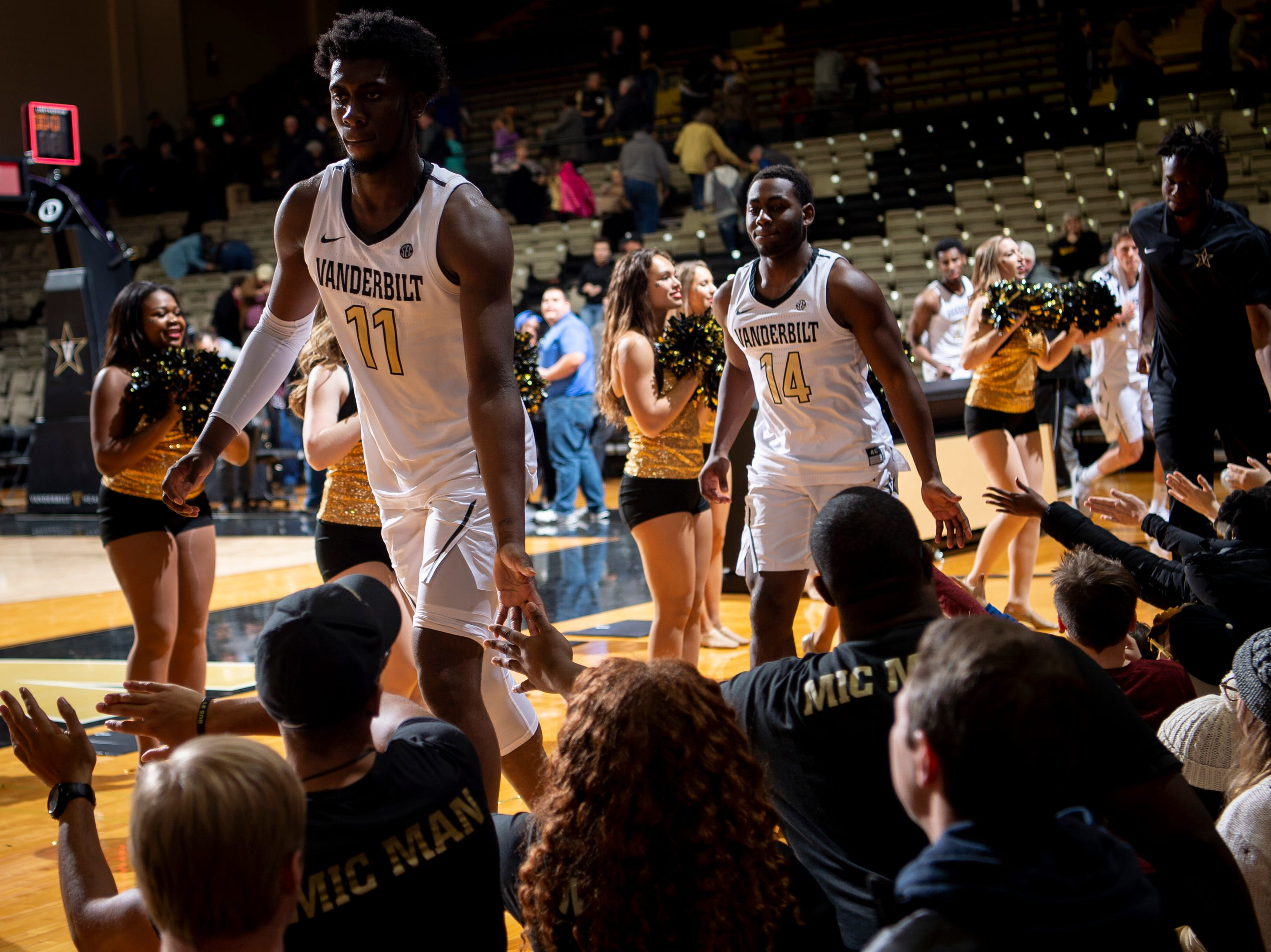 Vanderbilt forward Simisola Shittu (11) celebrates with fans after defeating MTSU at Memorial Gym in Nashville, Tenn., Wednesday, Dec. 5, 2018.