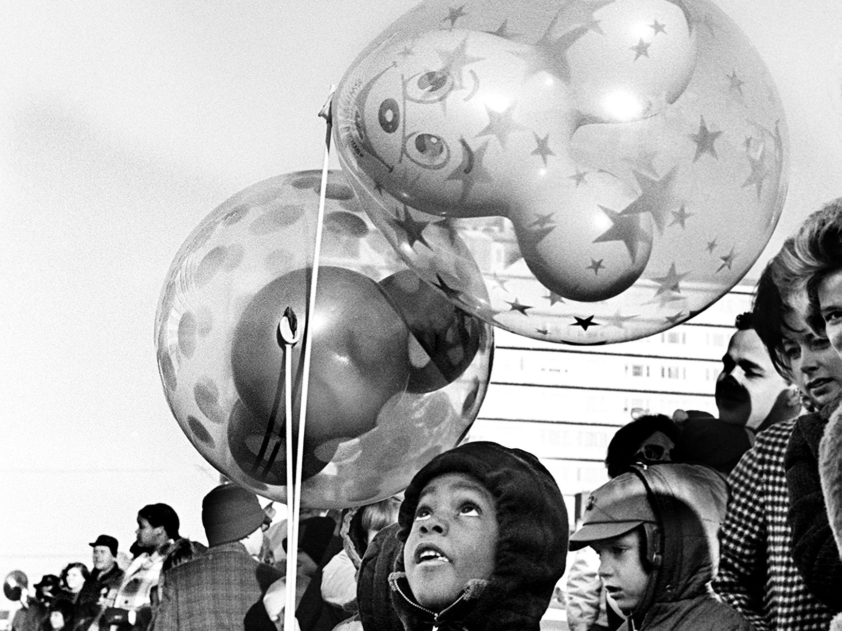 Kevin Rankin, 5, son of Mr. and Mrs. Billie Rankin, watches the chill wind whip his balloons during the 16th annual Nashville Christmas parade Dec. 8, 1968.