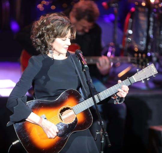 """""""It does my heart good to sing and play,"""" Amy Grant says."""