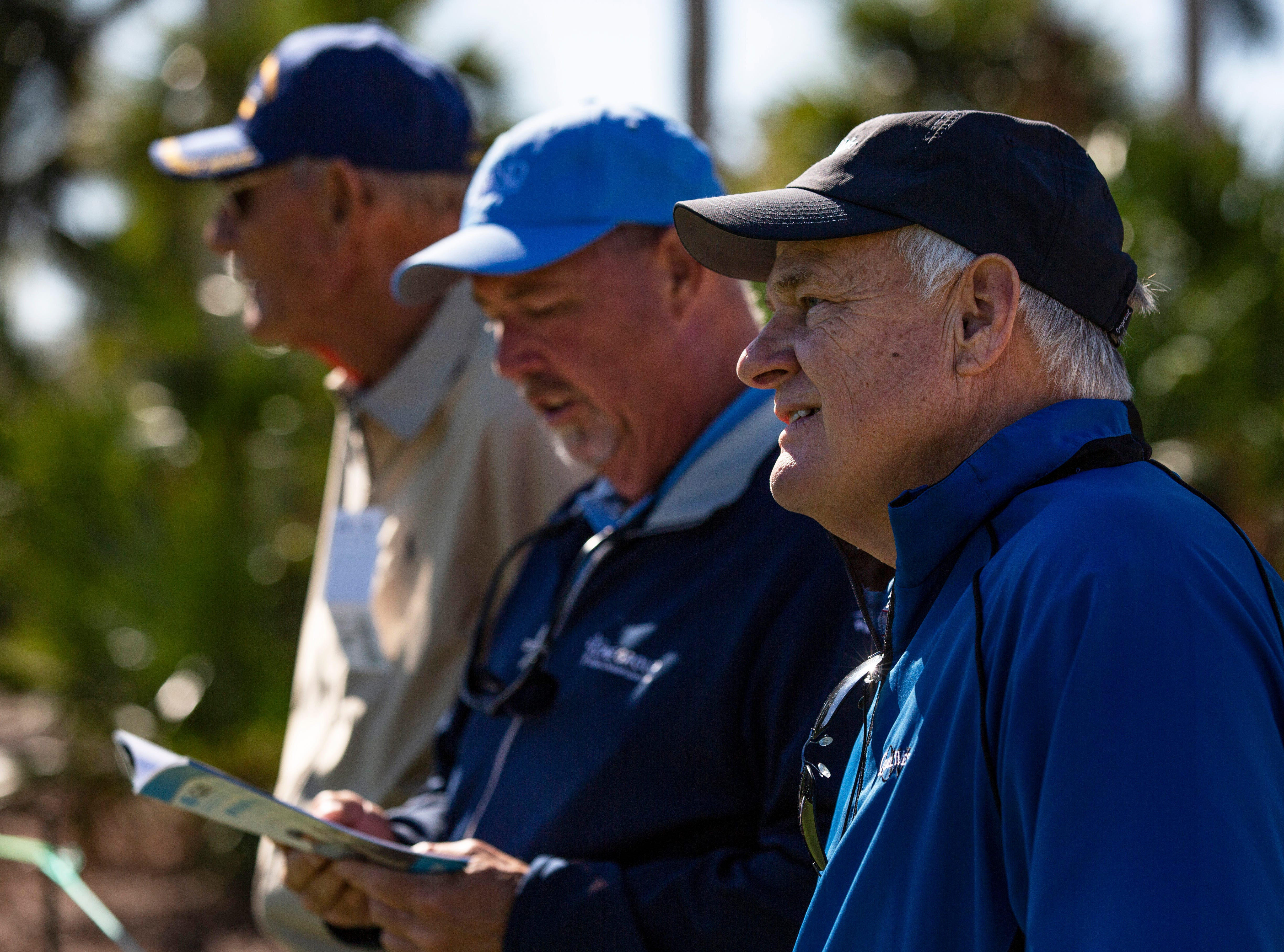 From the right, Andy Pickering, Joe Isnardi and Jim LaFevre watch various groups during the 30th annual QBE Shootout Pro - Amateur round two, on Thursday, Dec. 6, 2018, at Tiburón Golf Club in Naples.