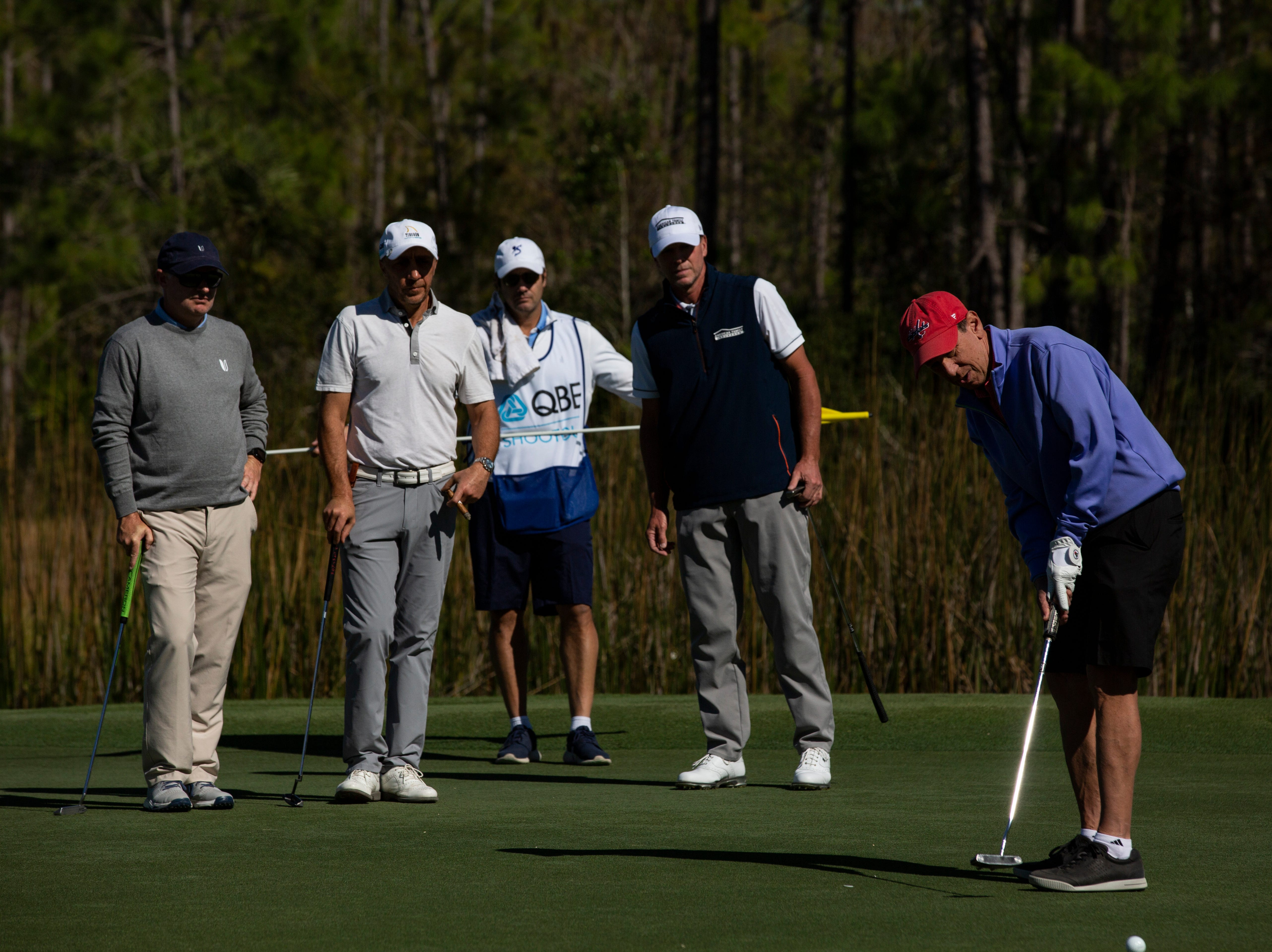 Neil Cohen putts the ball while his group consisting of Steve Stricker (right) watches Cohen patiently during the 30th annual QBE Shootout Pro - Amateur round two, on Thursday, Dec. 6, 2018, at Tiburón Golf Club in Naples.