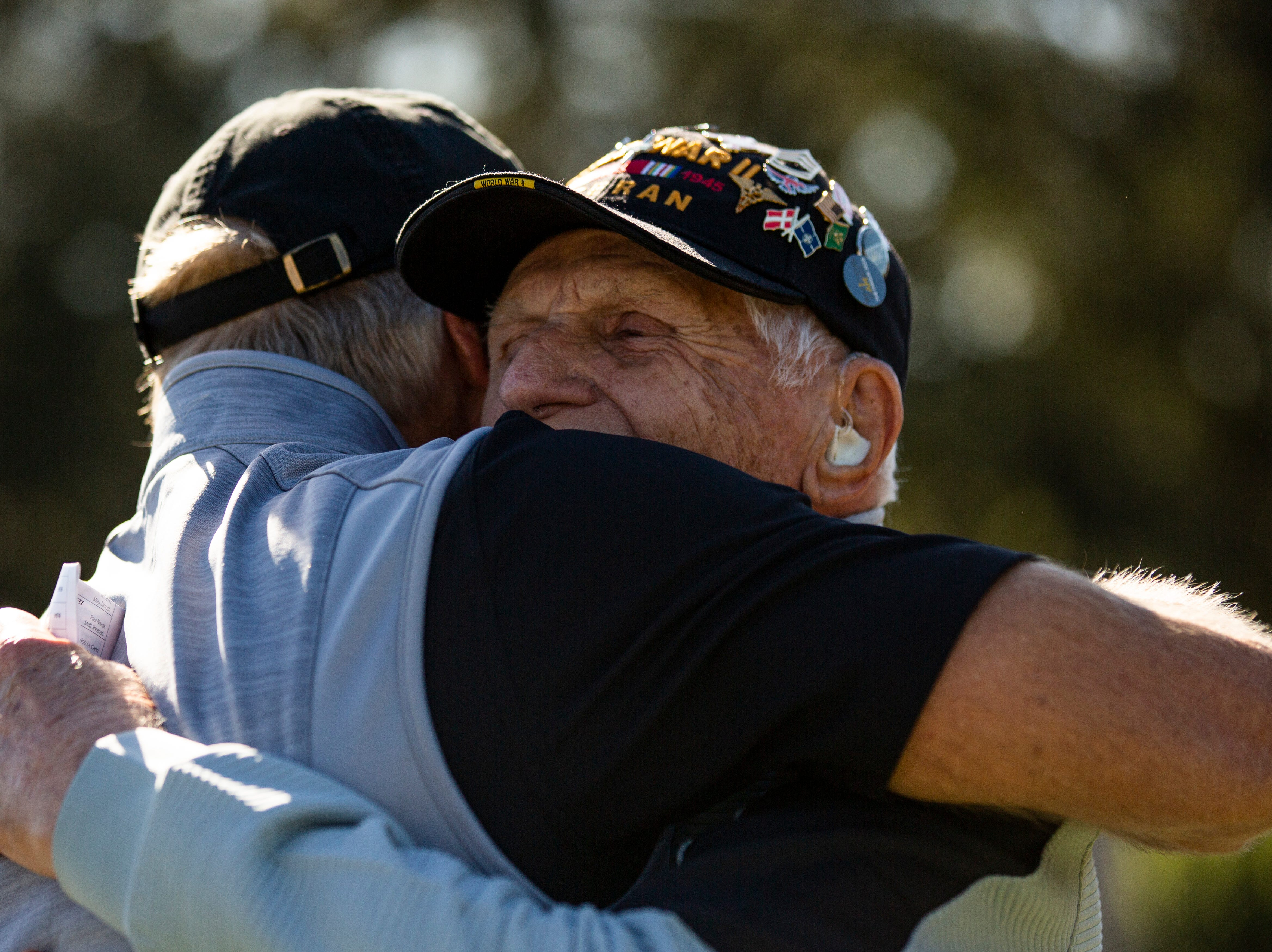 Greg Norman of Australia, shares a moment with 98-year-old Steve Melnikoff, one of the oldest surviving WWII veterans, before teeing off for the second pro-am round during the 30th annual QBE Shootout Pro - Amateur round two, on Thursday, Dec. 6, 2018, at Tiburón Golf Club in Naples.