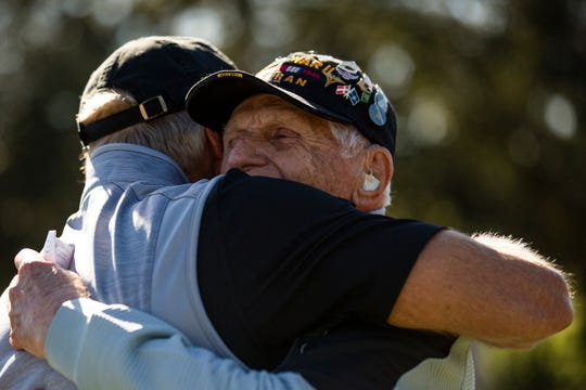Greg Norman shares a moment with 98-year-old Steve Melnikoff, one of the oldest surviving WWII veterans, before teeing off for the second pro-am round during the 30th annual QBE Shootout Pro-Am on Thursday at Tiburón Golf Club.