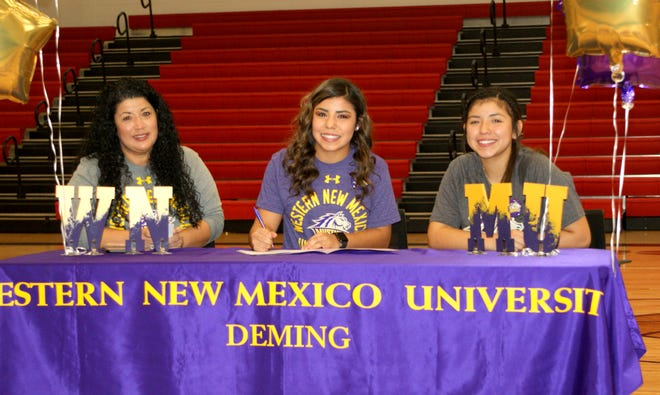 Mireya Trujillo, center, made a commitment to attend Western New Mexico University with an opportunity to play softball for the Mustangs. at left is her mother Carmen Jimenez and at right is sister Nayeli Trujillo.