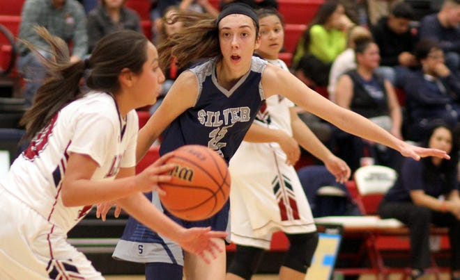 Lady Colt Katelynn Limardo shadows Deming's Nicole Lopez on defense. The 6-foot-2 Limardo led all scorers with 27 points in Silver's 64-51 loss.