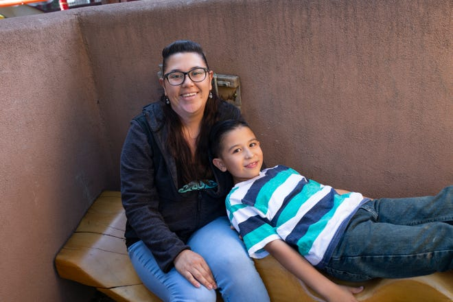 Heather LeDoux, and her 8-year-old son Adam.