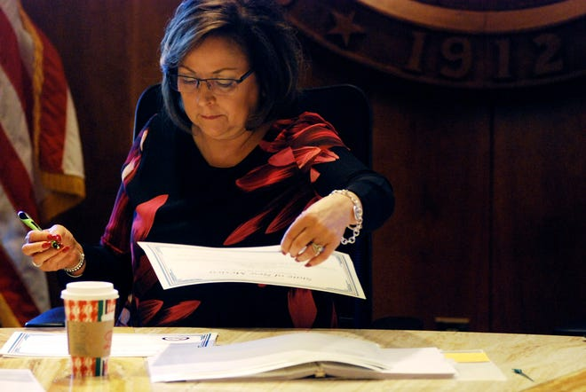 New Mexico Gov. Susana Martinez helps certify election results and order recounts in a handful of state House races in Santa Fe on Tuesday, Nov. 27, 2018. New Mexico is certifying election results that give Democrats unfettered control of every statewide office and the state's five-member delegation to Capitol Hill.