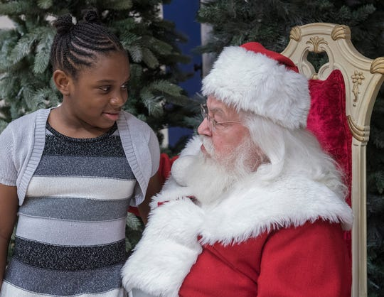 Kaleigh Swindell visits with Santa Claus.