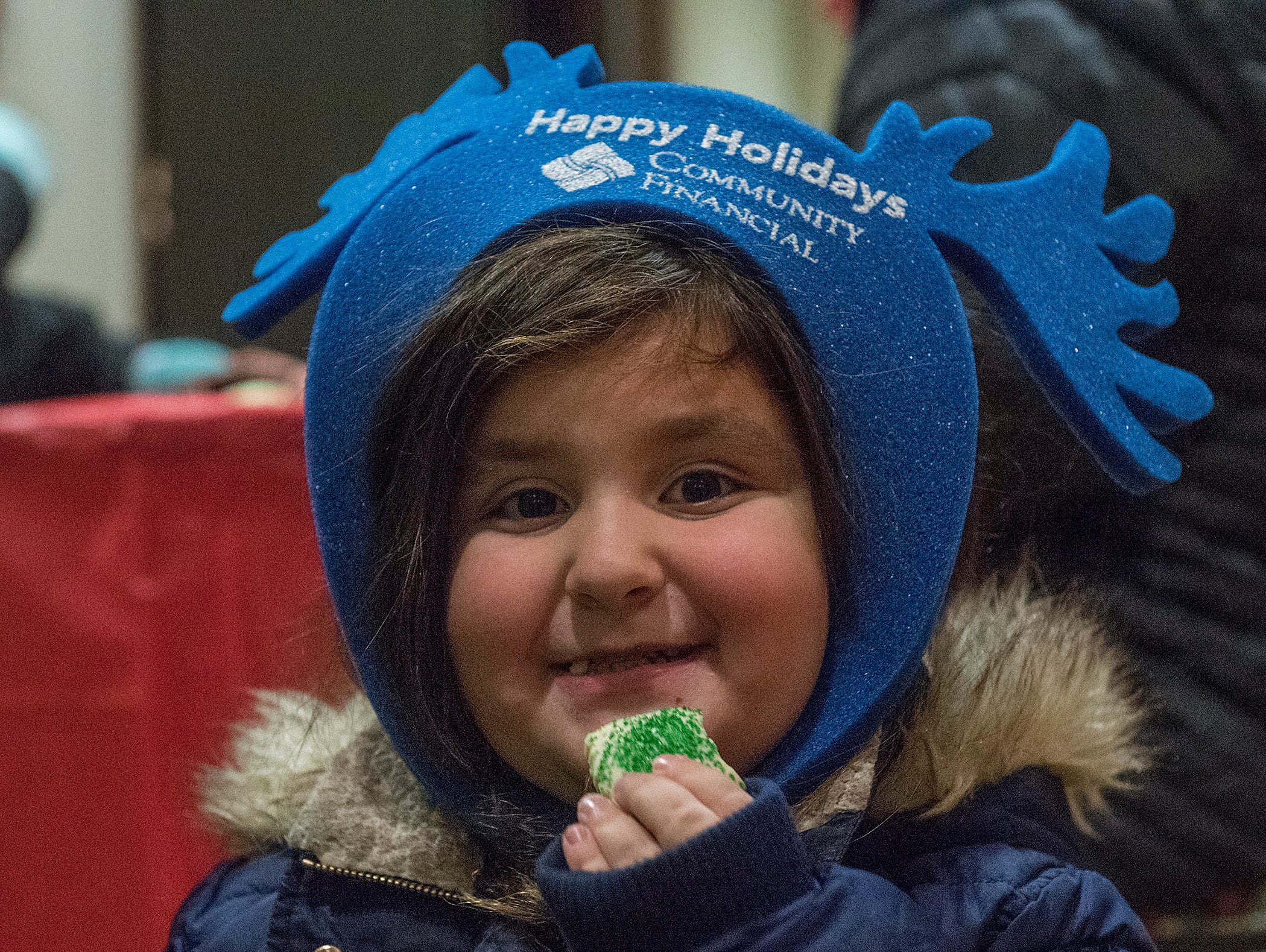 Ava Nies enjoys her Christmas cookie.