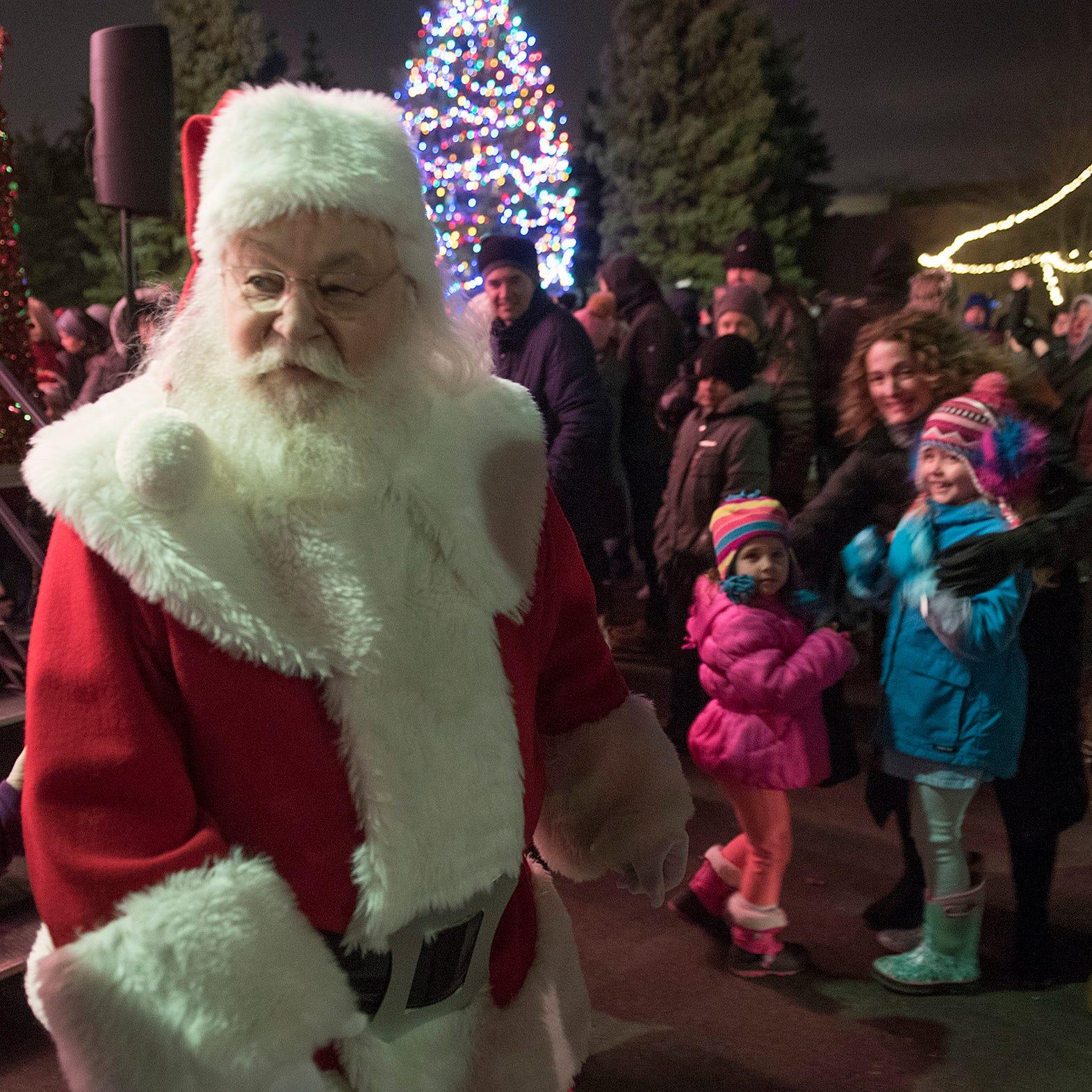 Santa lights Canton's tree, kicks off holiday season