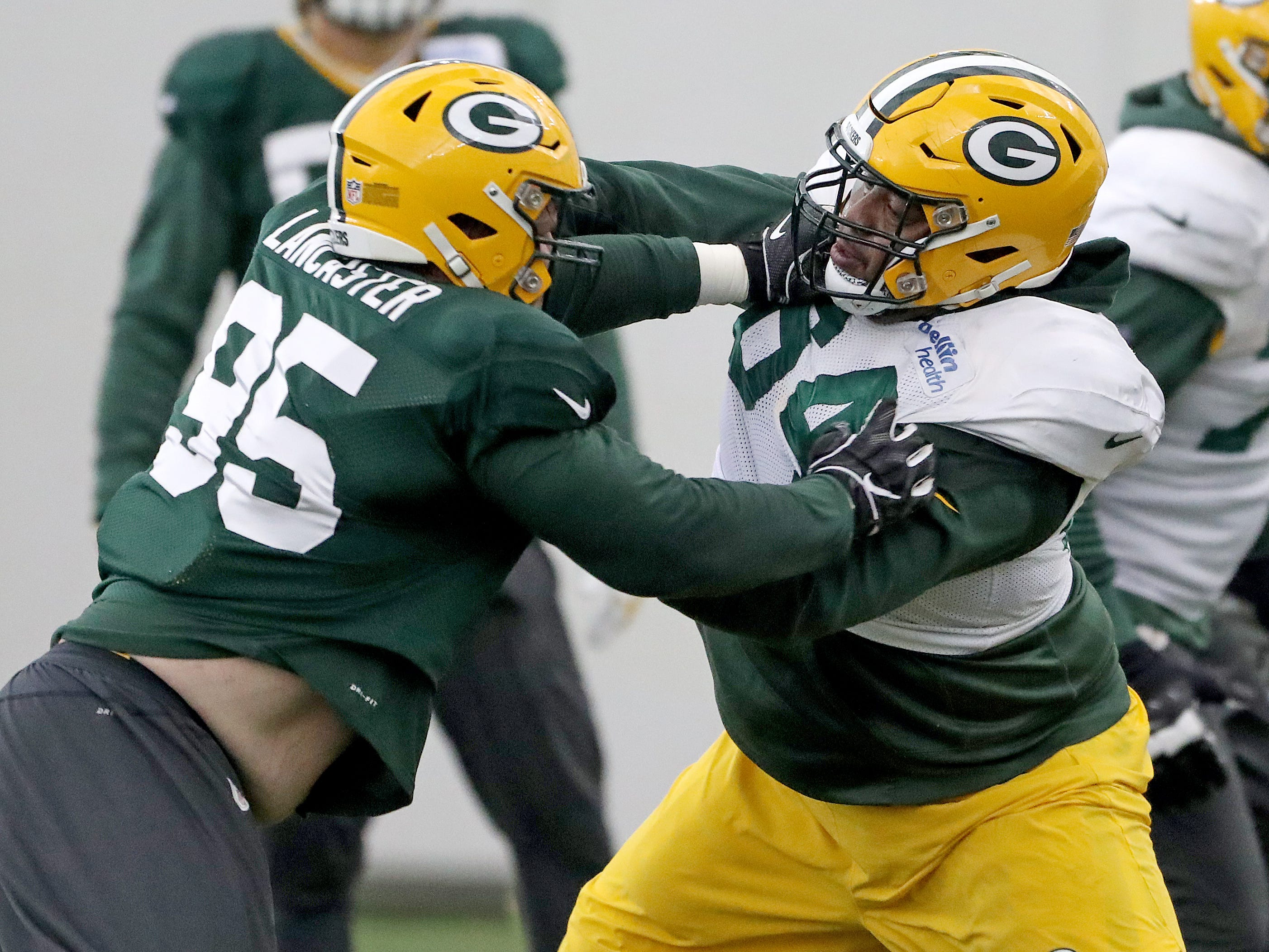 Green Bay Packers defensive tackle Tyler Lancaster (95) and offensive guard Justin McCray (64) during practice Thursday, December 6, 2018 inside the Don Hutson Center in Ashwaubenon, WIs.