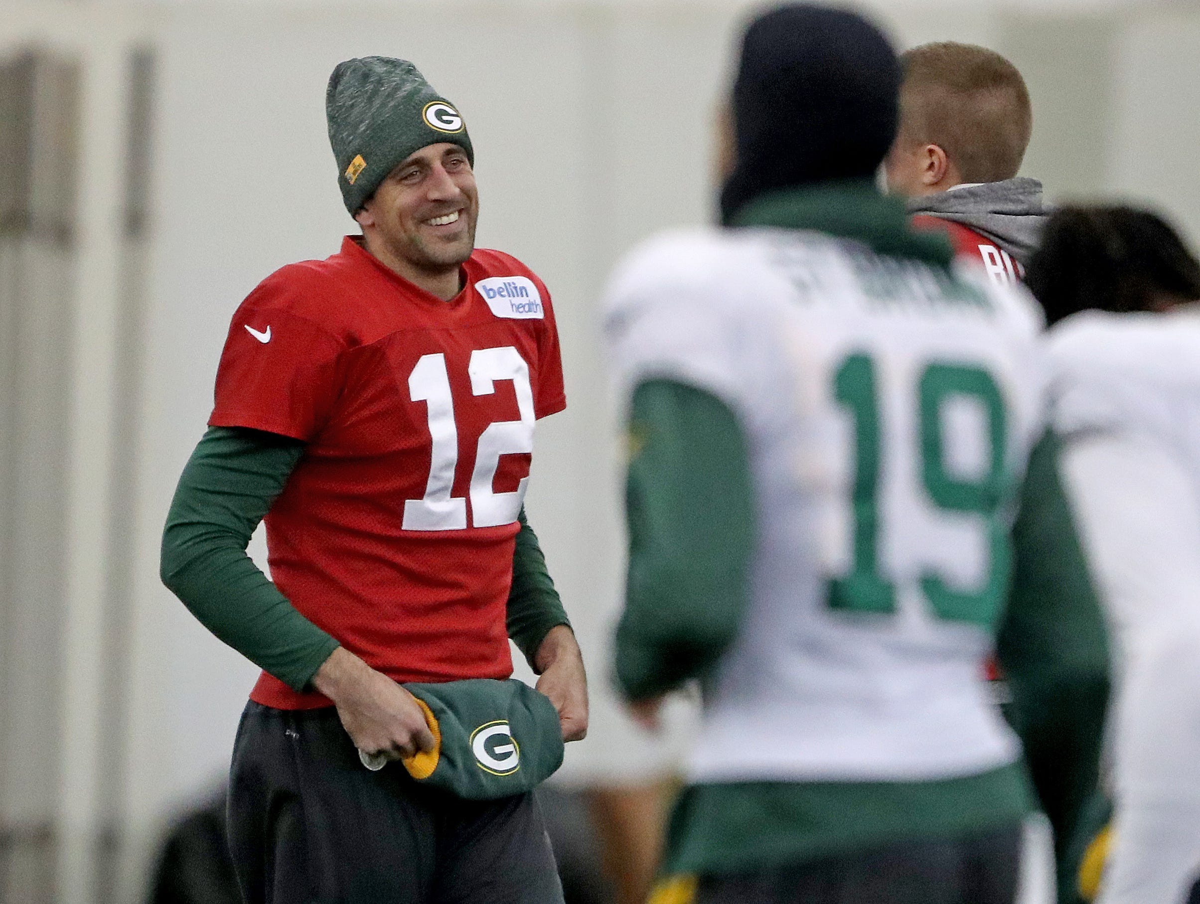 Green Bay Packers quarterback Aaron Rodgers (12) smiles during warmups at practice Thursday, December 6, 2018 inside the Don Hutson Center in Ashwaubenon, WIs.