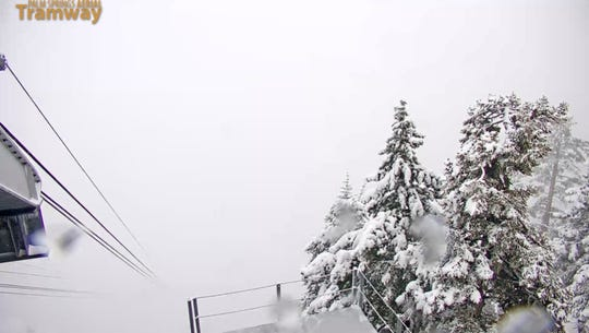 This screen grab from the Palm Springs Aerial Tramway's website on Thursday morning shows accumulated snow and white-out conditions in the San Jacinto Mountains.