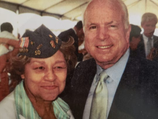 Lita Bowman, now 91, was photographed with the late Sen. John McCain when the battleship Pearl Harbor was christened in May 1998 in San Diego.