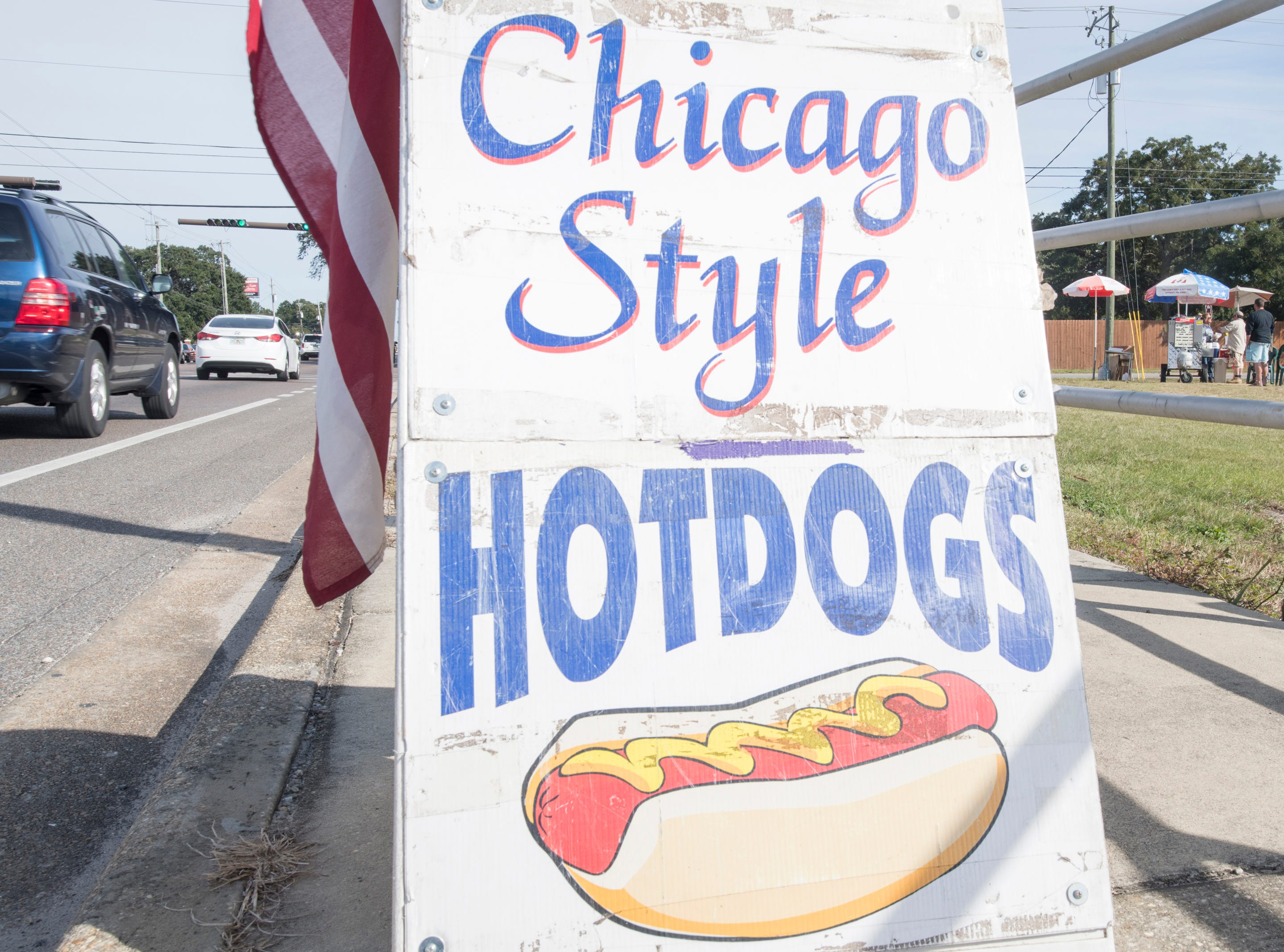 Owner and native-Chicagoan Ray Gluszek serves up Chicago Style dogs at his RG's Cafe hot dog stand on Barrancas Avenue in Warrington on Thursday, December 6, 2018.