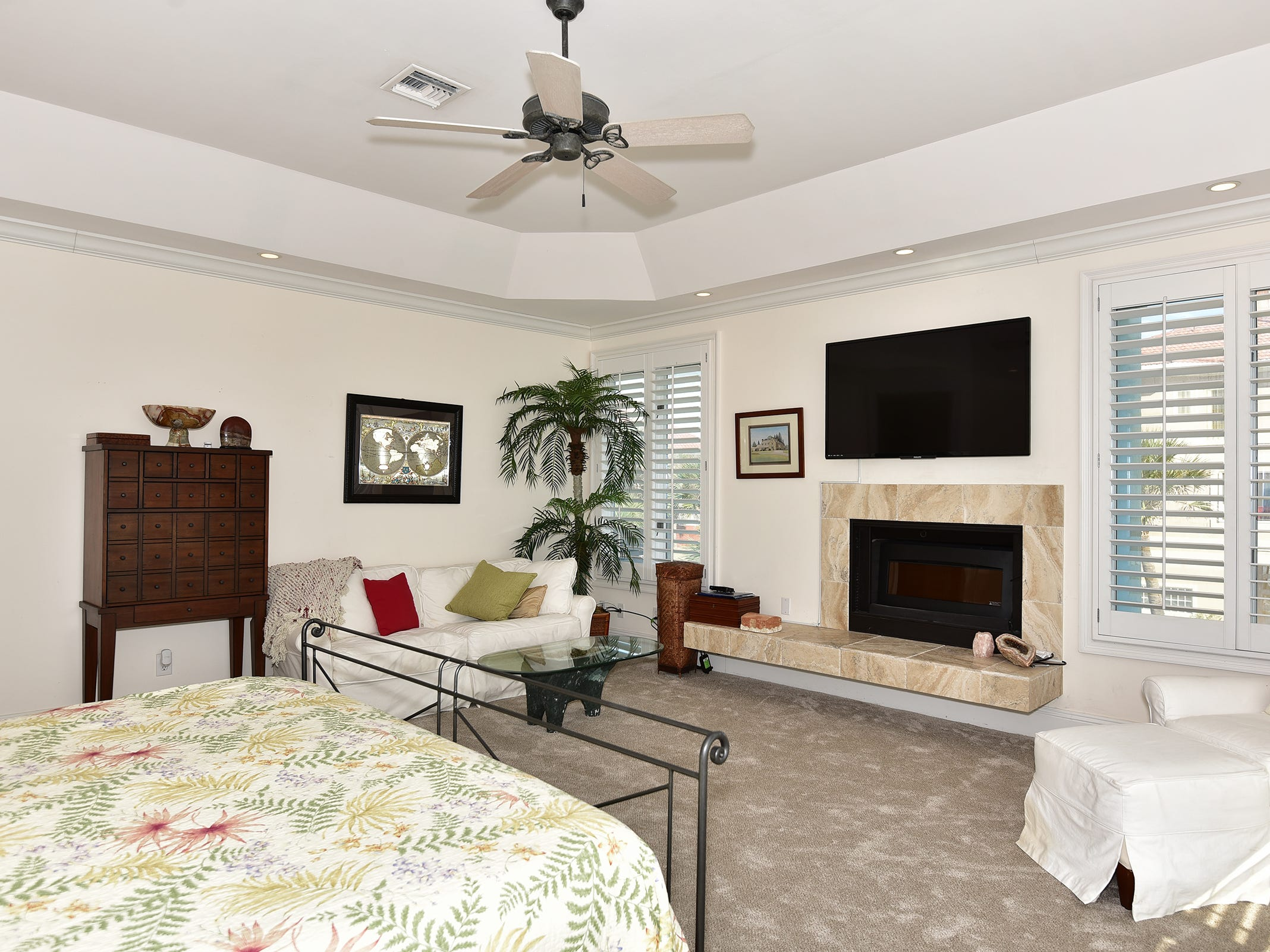 28 Calle HermosaThe master bedroom includes a cozy fireplace.