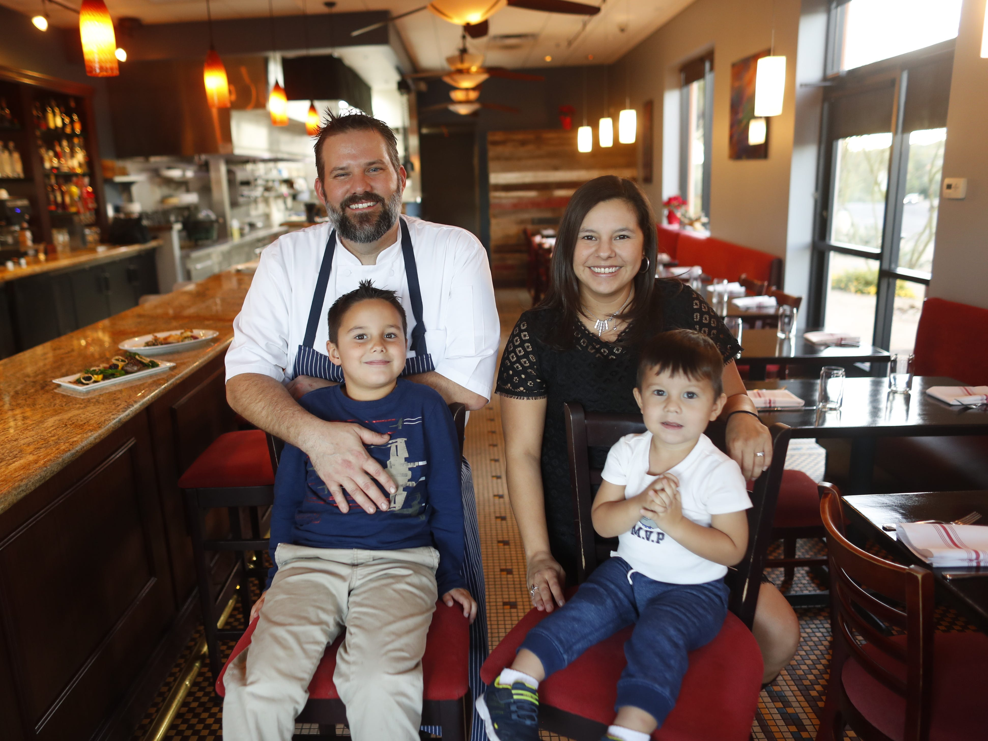 Chef Brandon Gauthier and his wife and house manager Victoria Gauthier with their children Jackson, 5, (L) and Elijah, 2, at Confluence in Carefree, Ariz. on December 3, 2018.