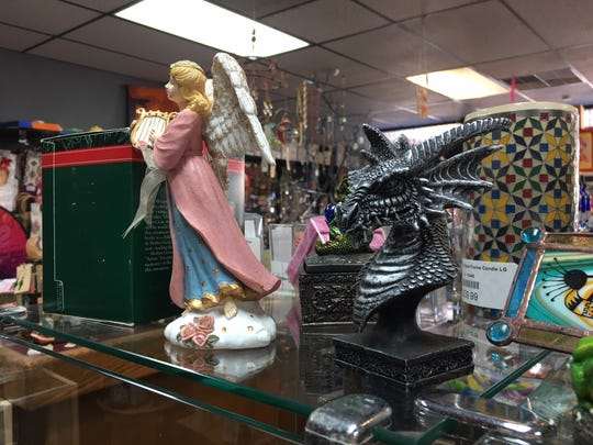 A dragon and fairy statue at the Whozitz & Whatzitz store.