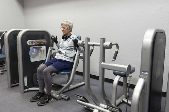 Judy Mellen uses exercise room at The Valley of the Sun YMCA. Mesa Family location is closing their doors on Dec 8th.