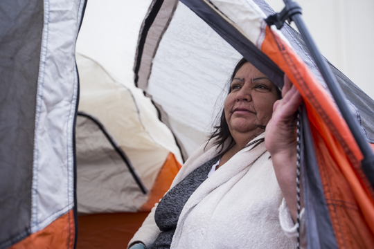 Rosa Vazquez, 56, waits in line to get free dental work on Dec. 6, 2018, at the Arizona State Fairgrounds in Phoenix.