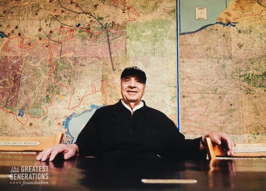 Greg Melikian posing for a picture in the room that the surrender of WWII took place at Musée de la Reddition in Reims, France.