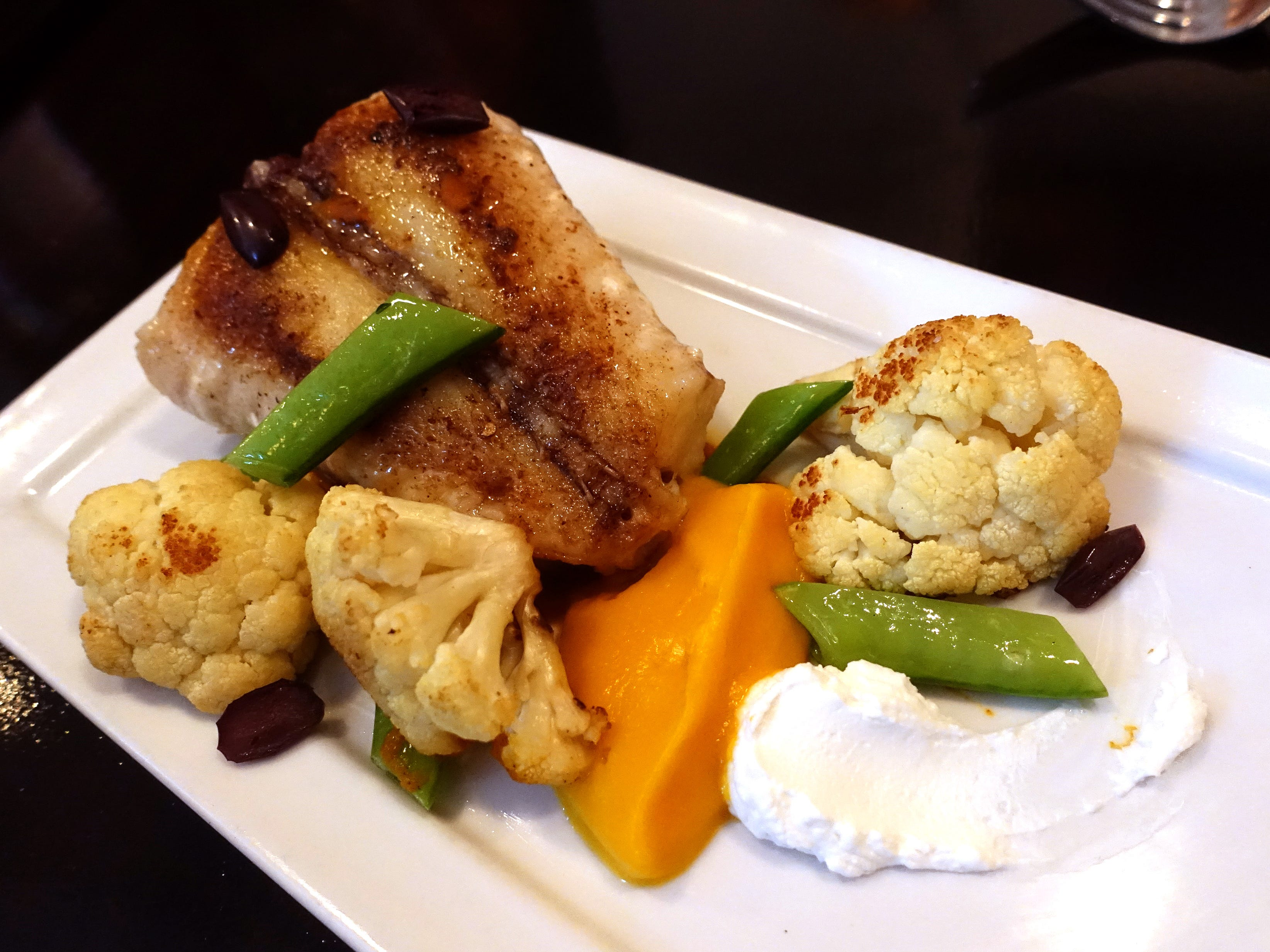 Monkfish with cauliflower, olive, sugar snap pea, labne, butternut squash and curry at Confluence in Carefree, AZ.