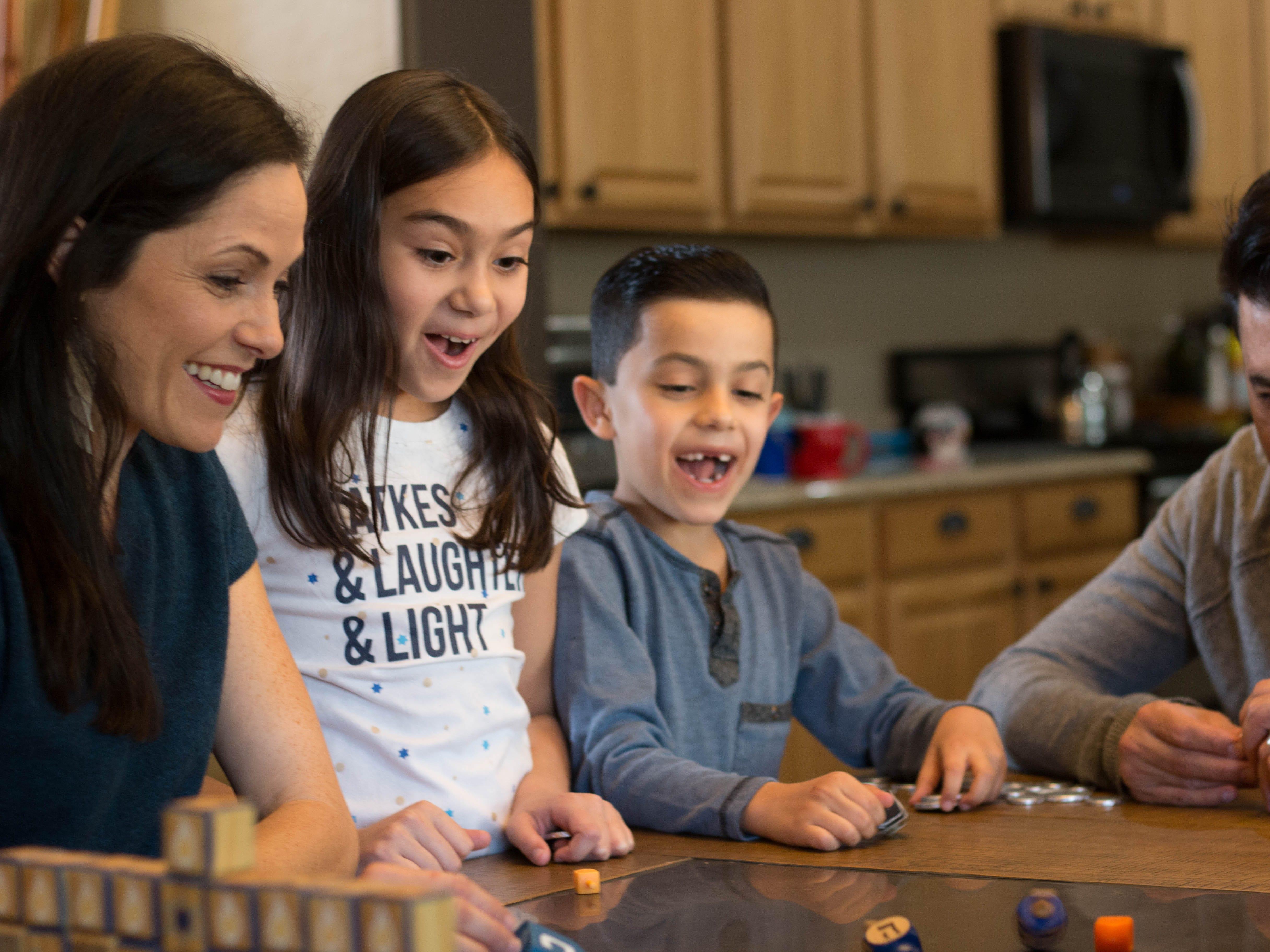 Hanukkah or Christmas? Interfaith families navigate how to raise their children