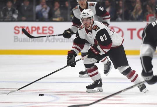 Coyotes right wing Conor Garland (83) takes the puck down ice during the first period of a preaseason game against the Kings on Sept. 22 at Staples Center.